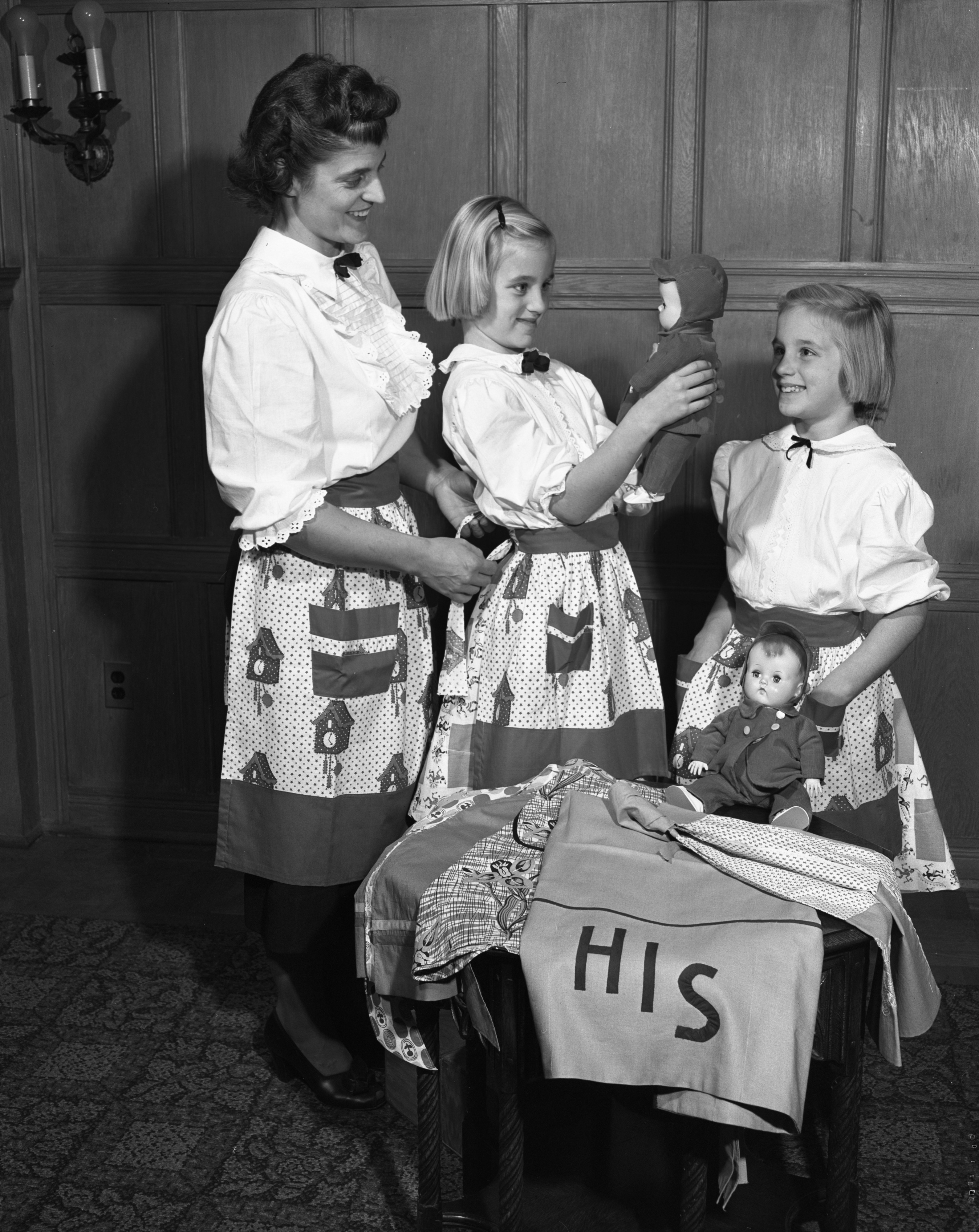 Mrs. John G. Young and Daughters Carol and Margaret Model Aprons, October 1951 image