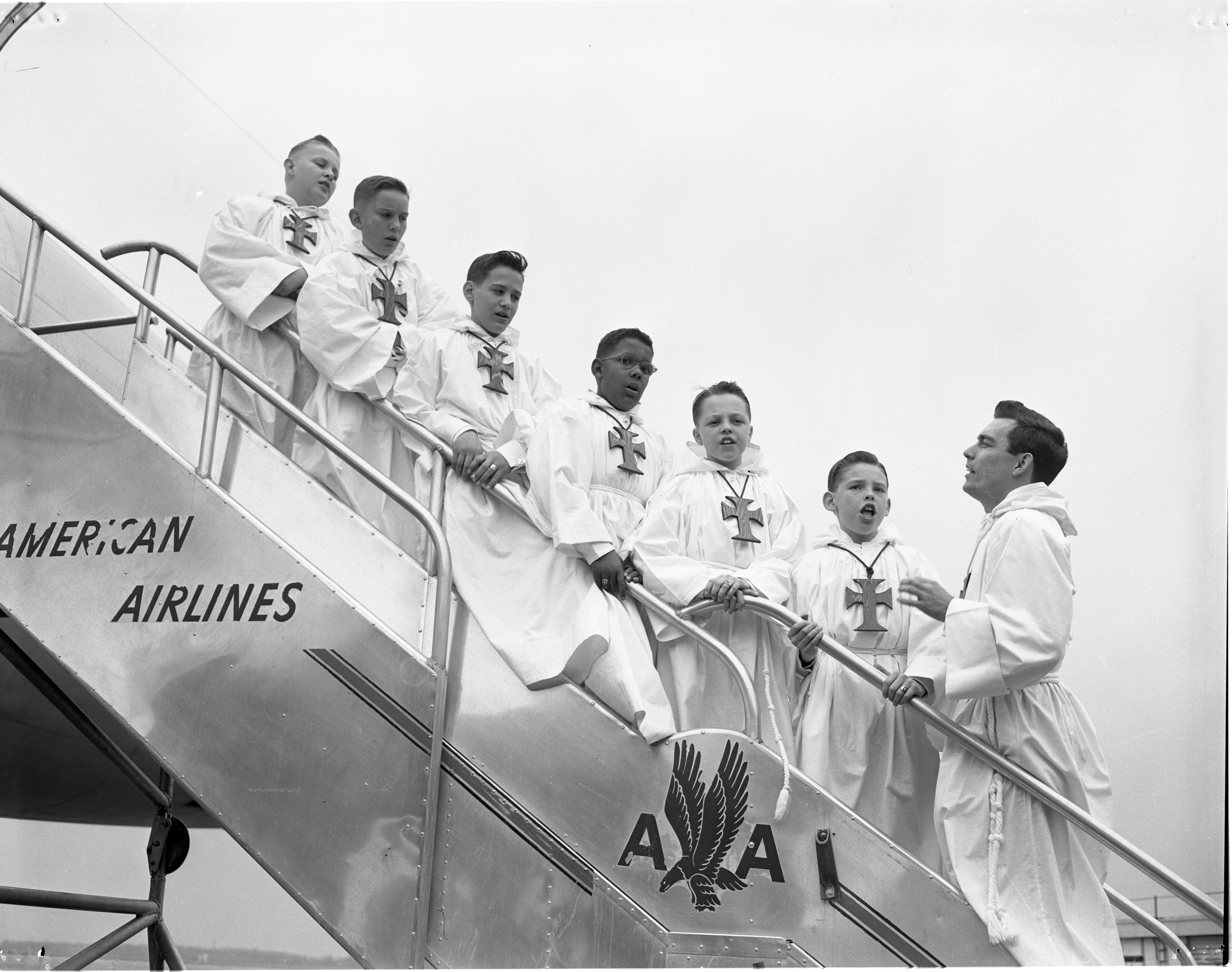 St. Thomas Catholic Church Choir Boys Board A Plane For Rome At Willow Run Airport - April 18, 1954 image