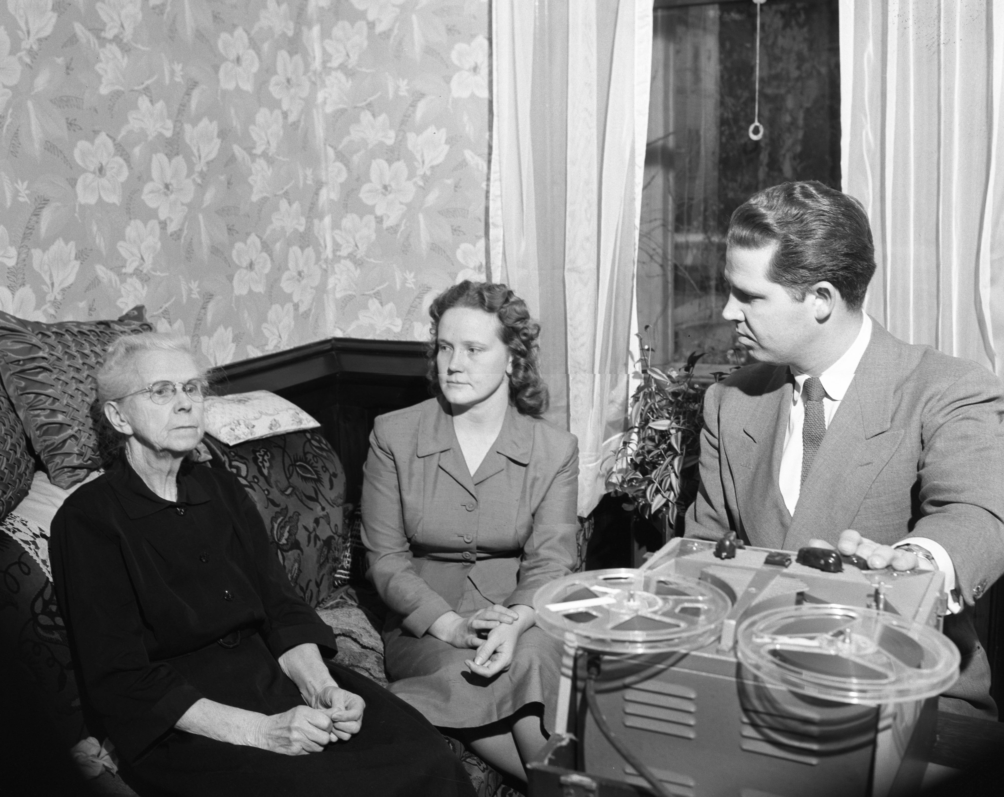 Mrs. Emma Milcer and Mr. and Mrs. Monroe Morford with Tape Recorder of Seventh Day Adventist Sermons, January 1958 image