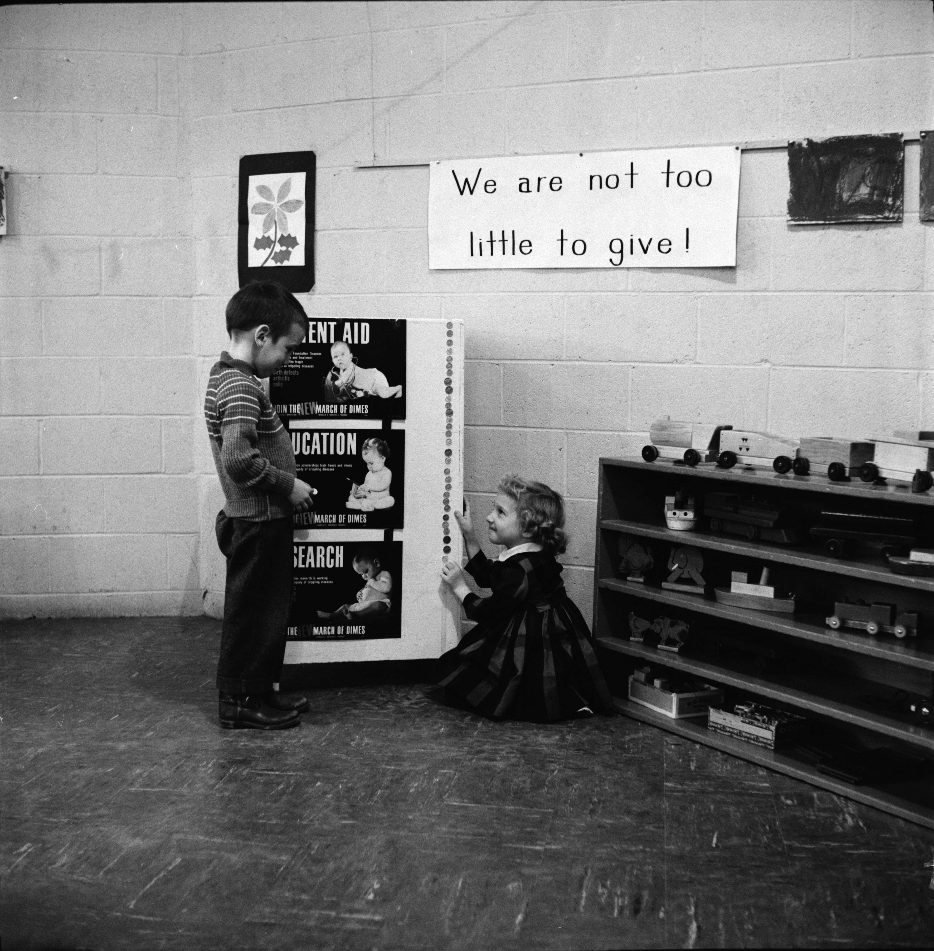 Mark Plant and Debra Hendrickson with March of Dimes Campaign Poster, January 1960 image