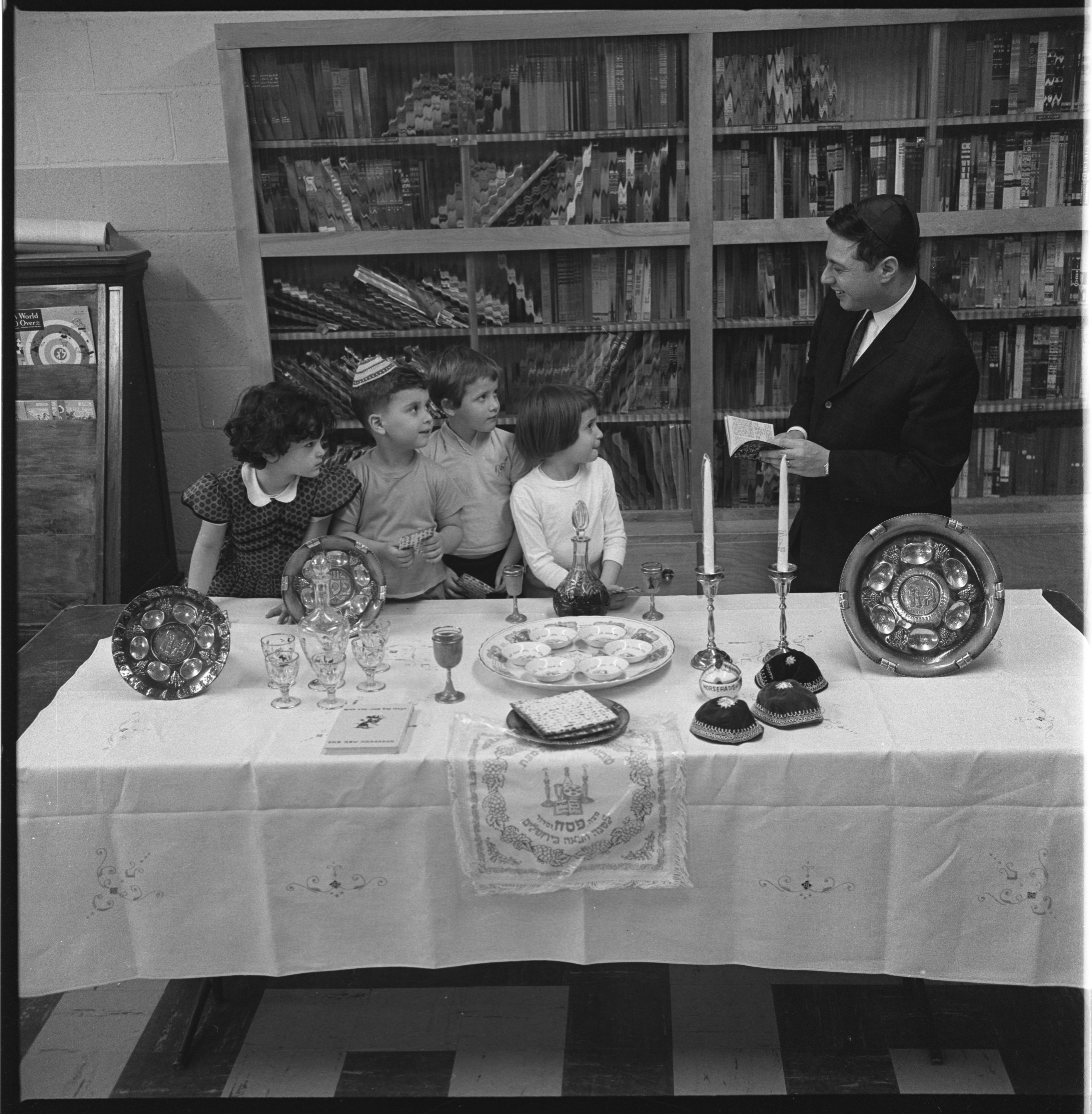Rabbi Harold White Reads To Children From The Haggadah, April 1963 image