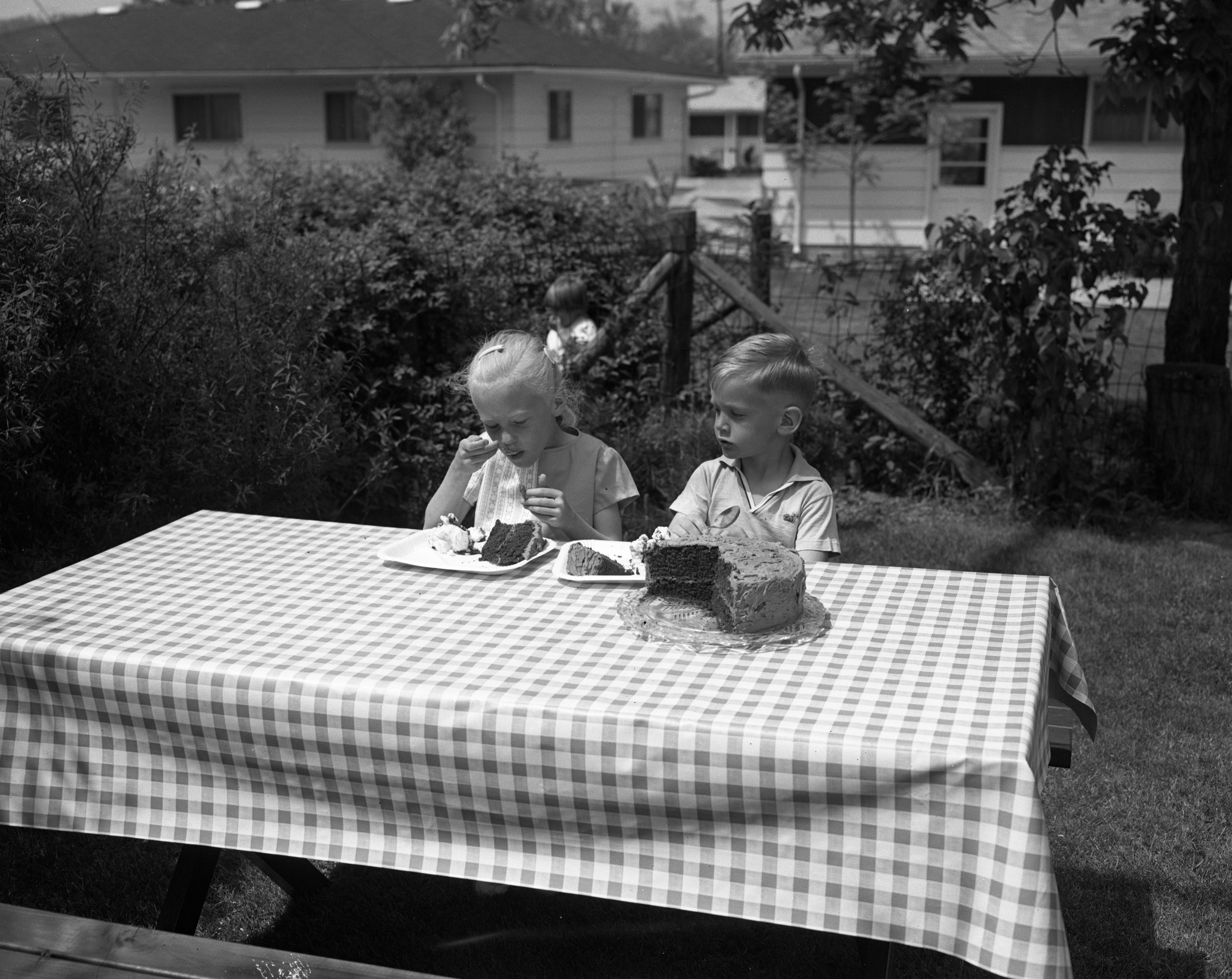 Reed Lenz and Pamela Robbins Sample Food For Ice Cream Social At Congregational Church, May 1963 image