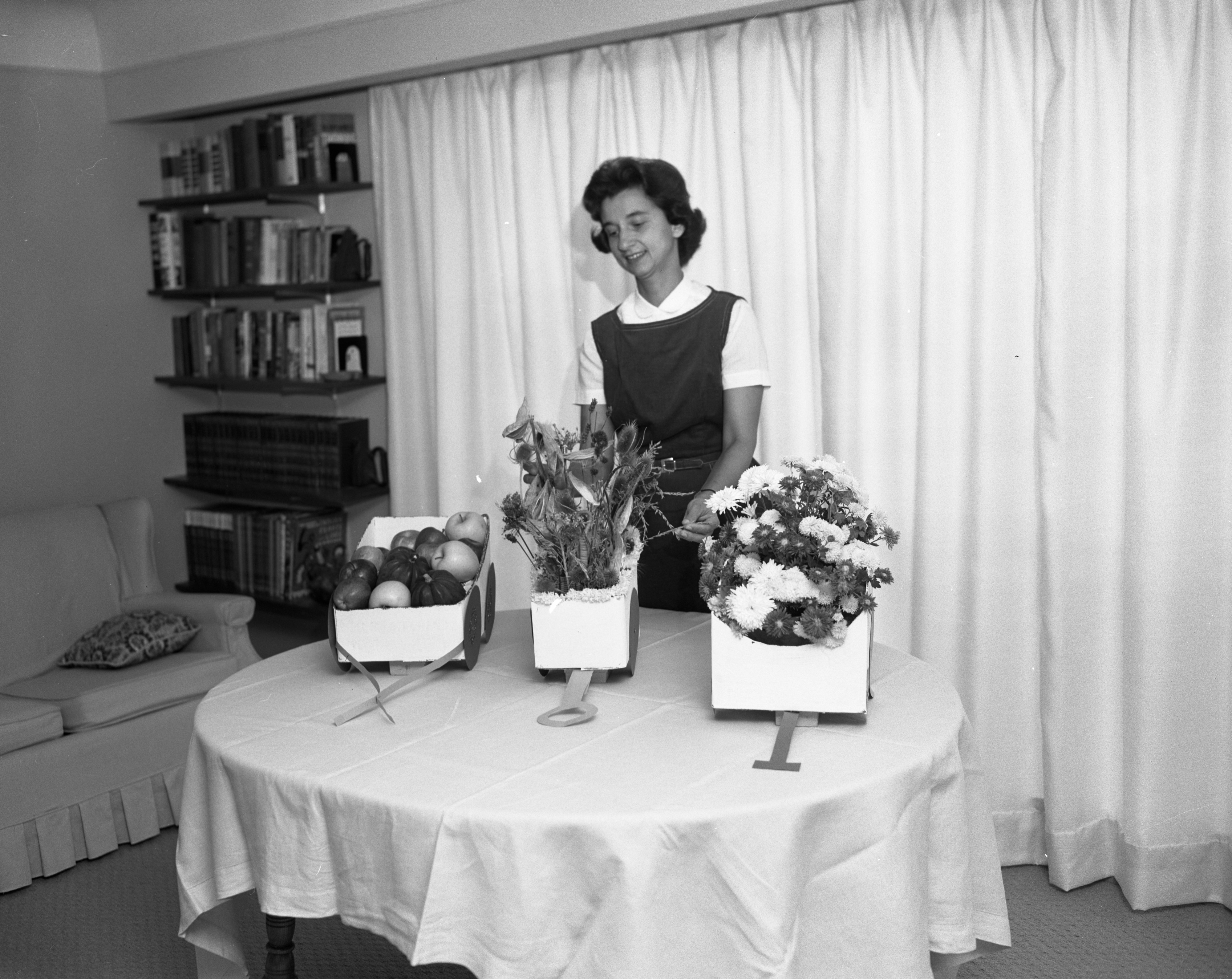 Mrs. William C. Castor Makes Table Decorations for First Unitarian Church Potluck Dinner, October 1963 image