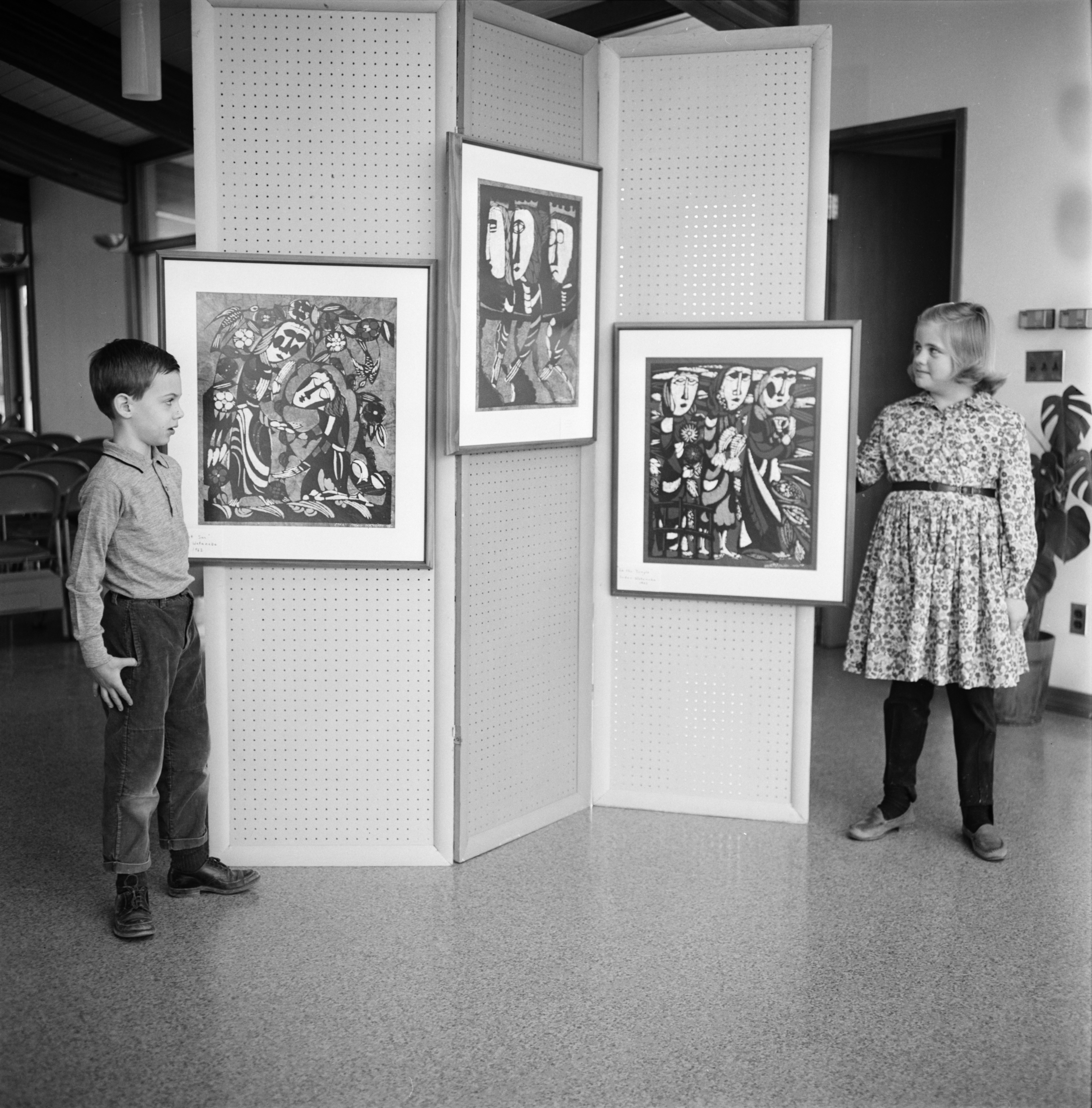 Peter Goodman and Karen Steinaway with Japanese prints at Church of the Good Shepherd, February 1965 image