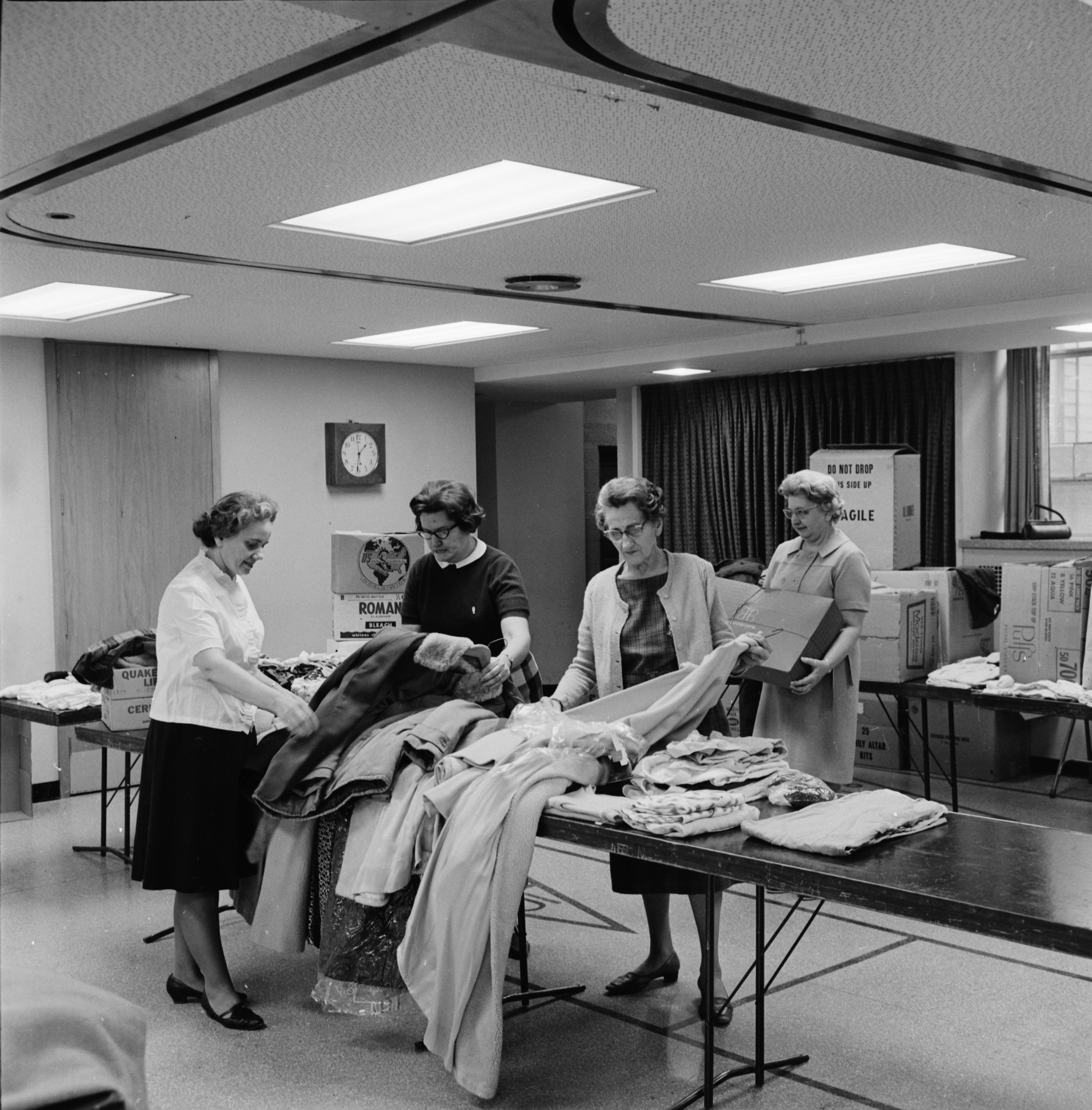 St. Paul's Lutheran Church Ladies Aid Packs Clothing for World Relief Drive, November 1967 image