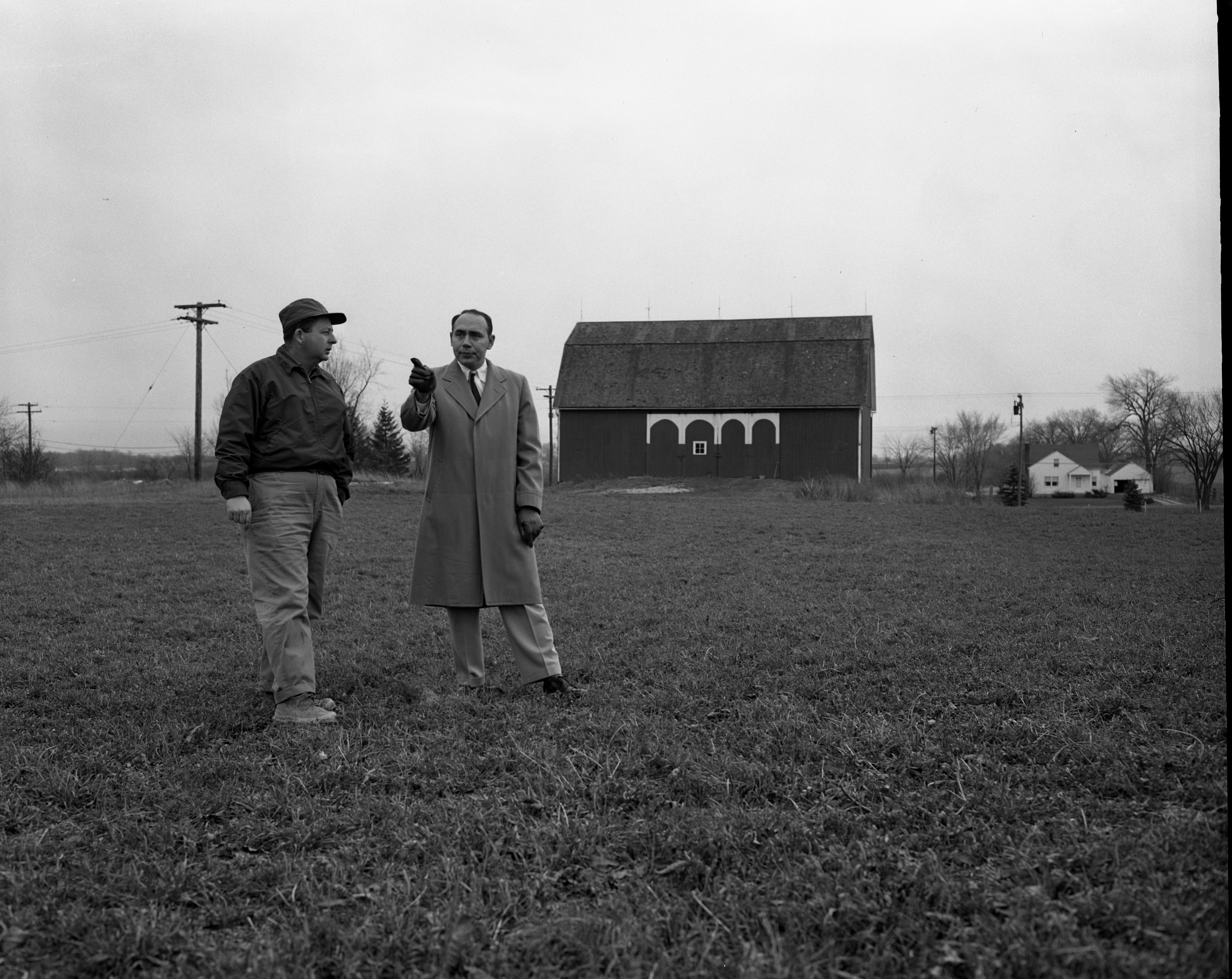 Rev. Richard H. Miller and George Frisinger at Site for New Presbyterian Church, November 1955 image