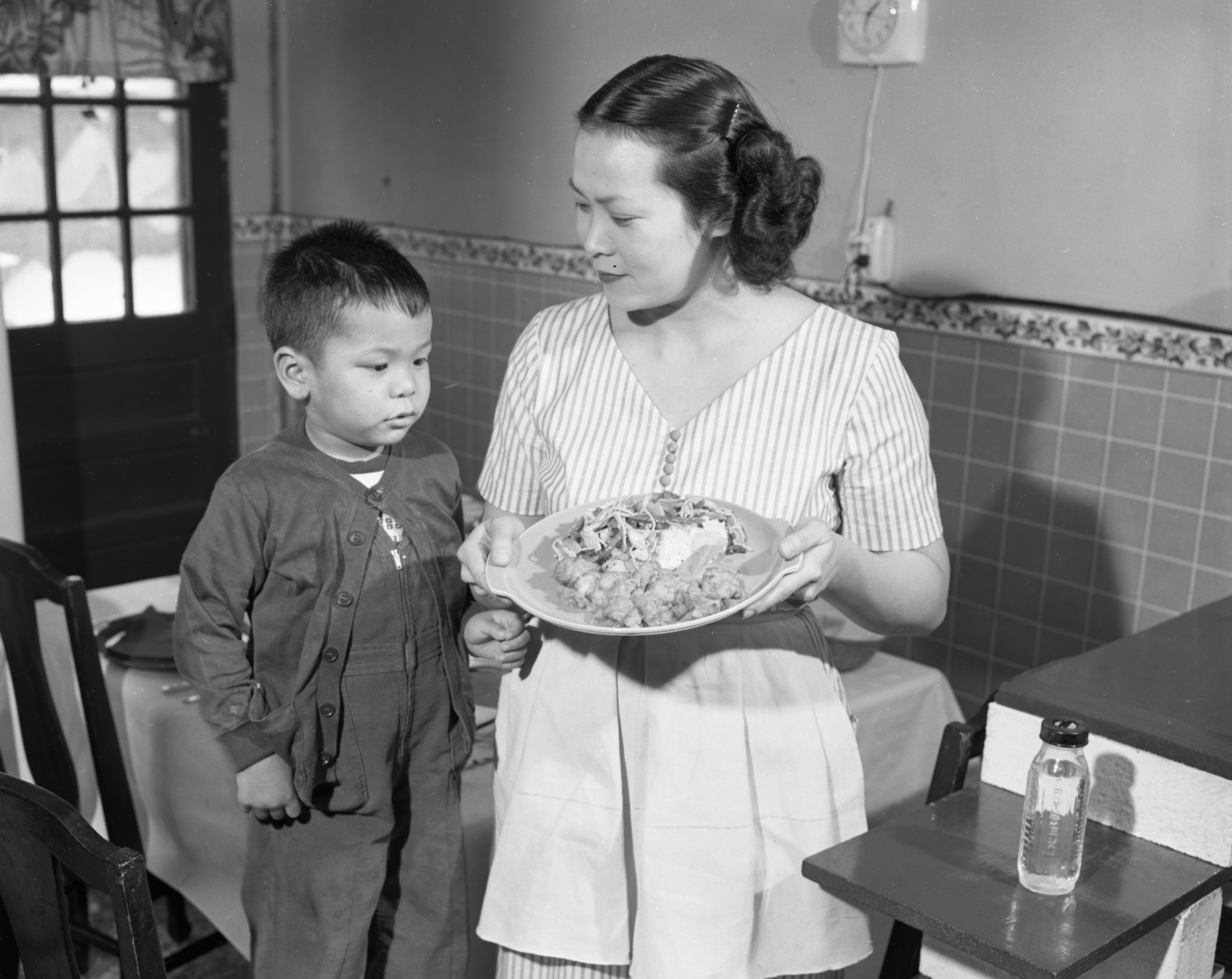 Image from Little Kimball Chun and Mrs. Kimball Chun with Chinese Shrimp and Vegetable Chop Suey, March 1954
