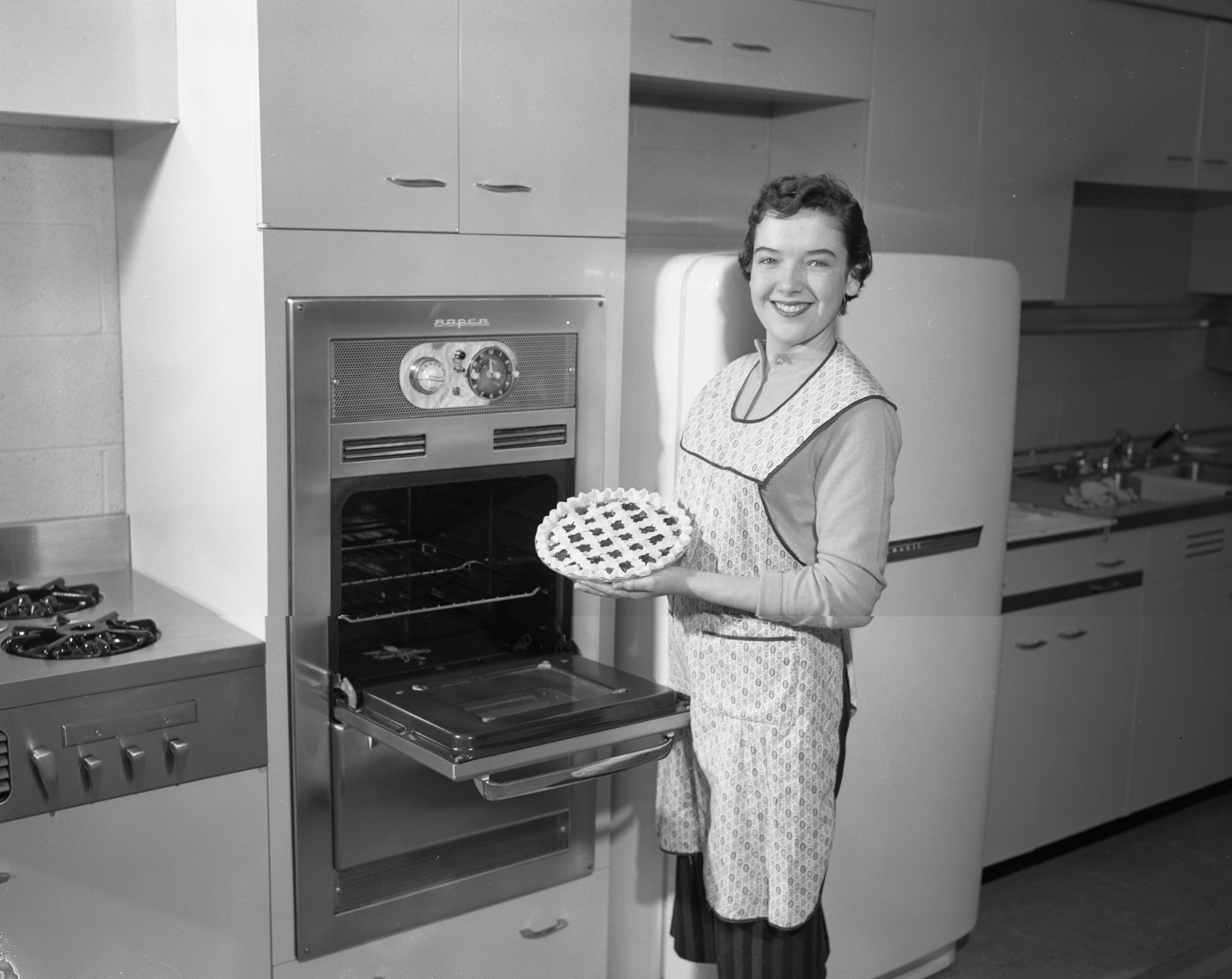 Kathleen Thompson with her prize-winning cherry pie, February 1957 image