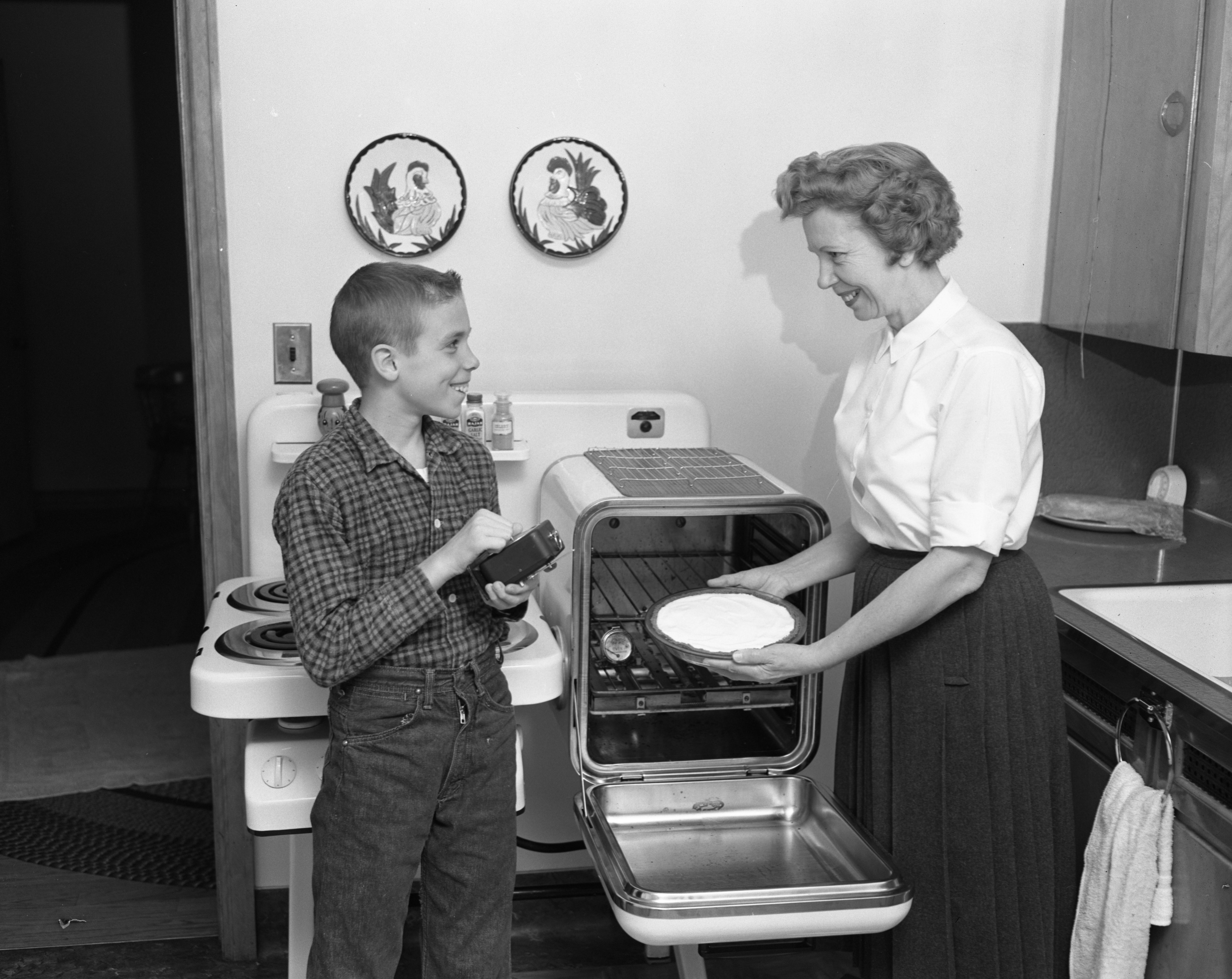 Lee Stansbury Sets A Timer For His Mother's Cheese Cake Pie, February 1961 image