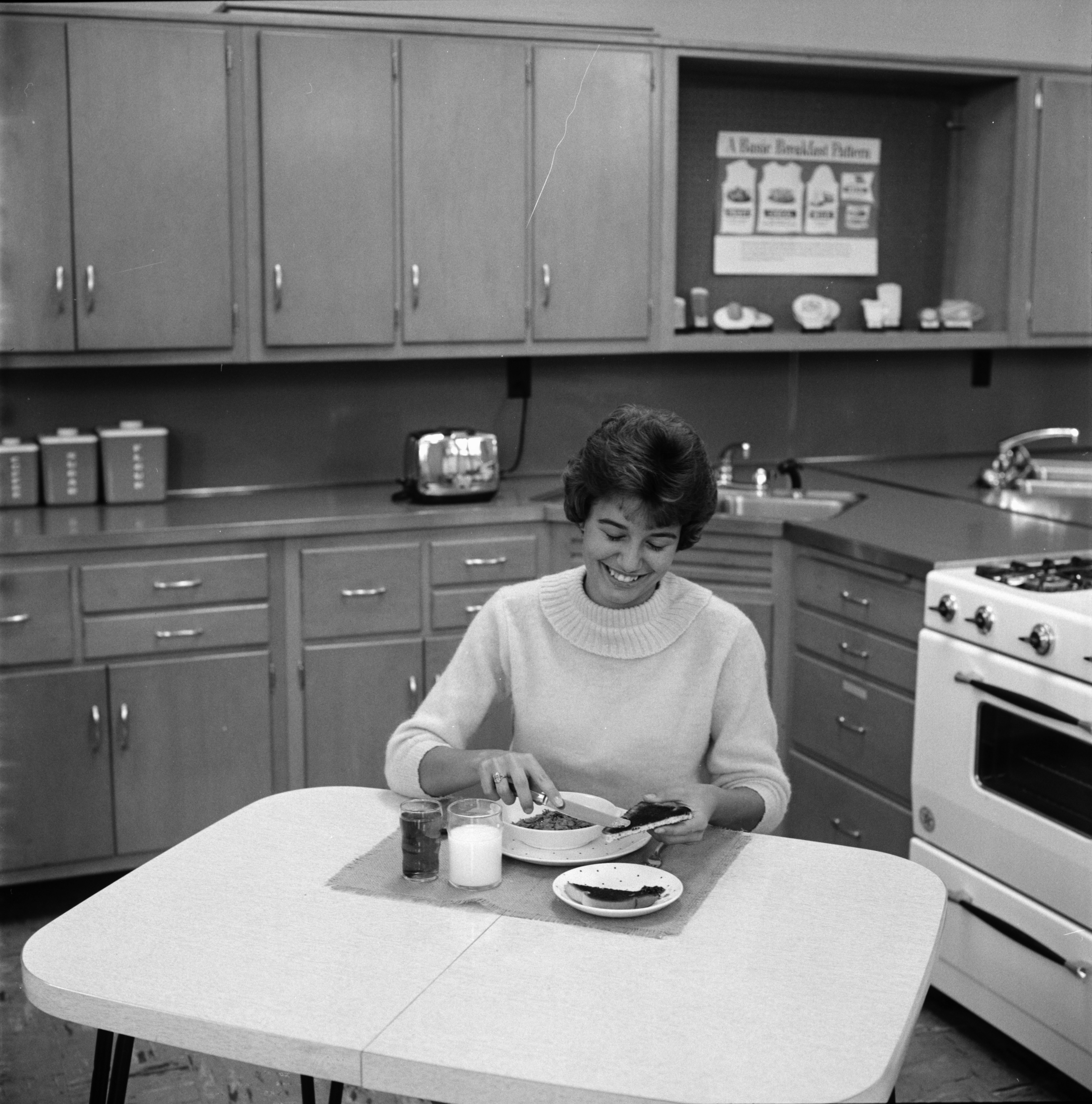 Toni Everard eats a well-balanced breakfast at Roosevelt High School, September 1961 image