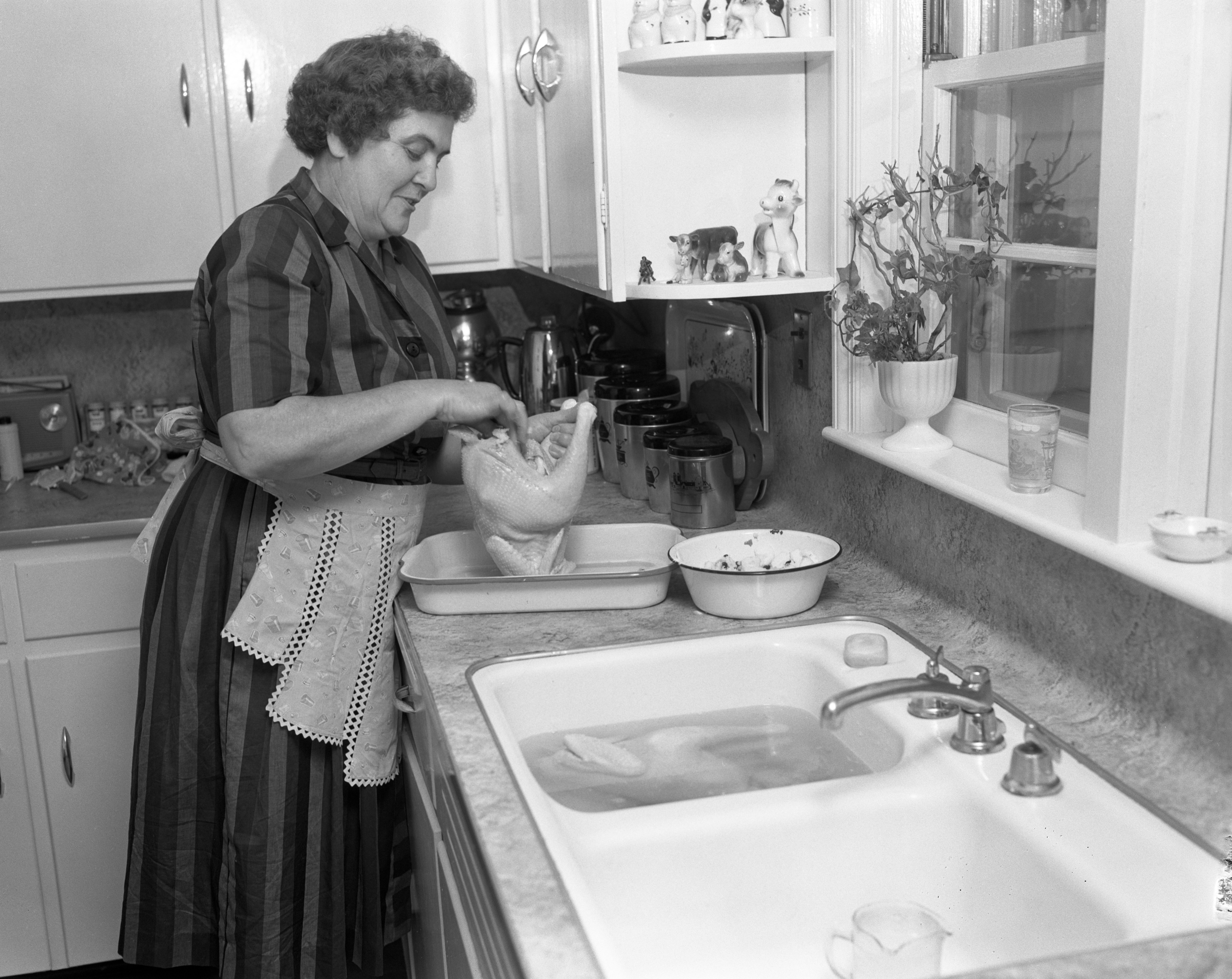 Mrs. Raymond Koch Prepares Roasted Chicken with Apple Raisin Dressing, November 1961 image