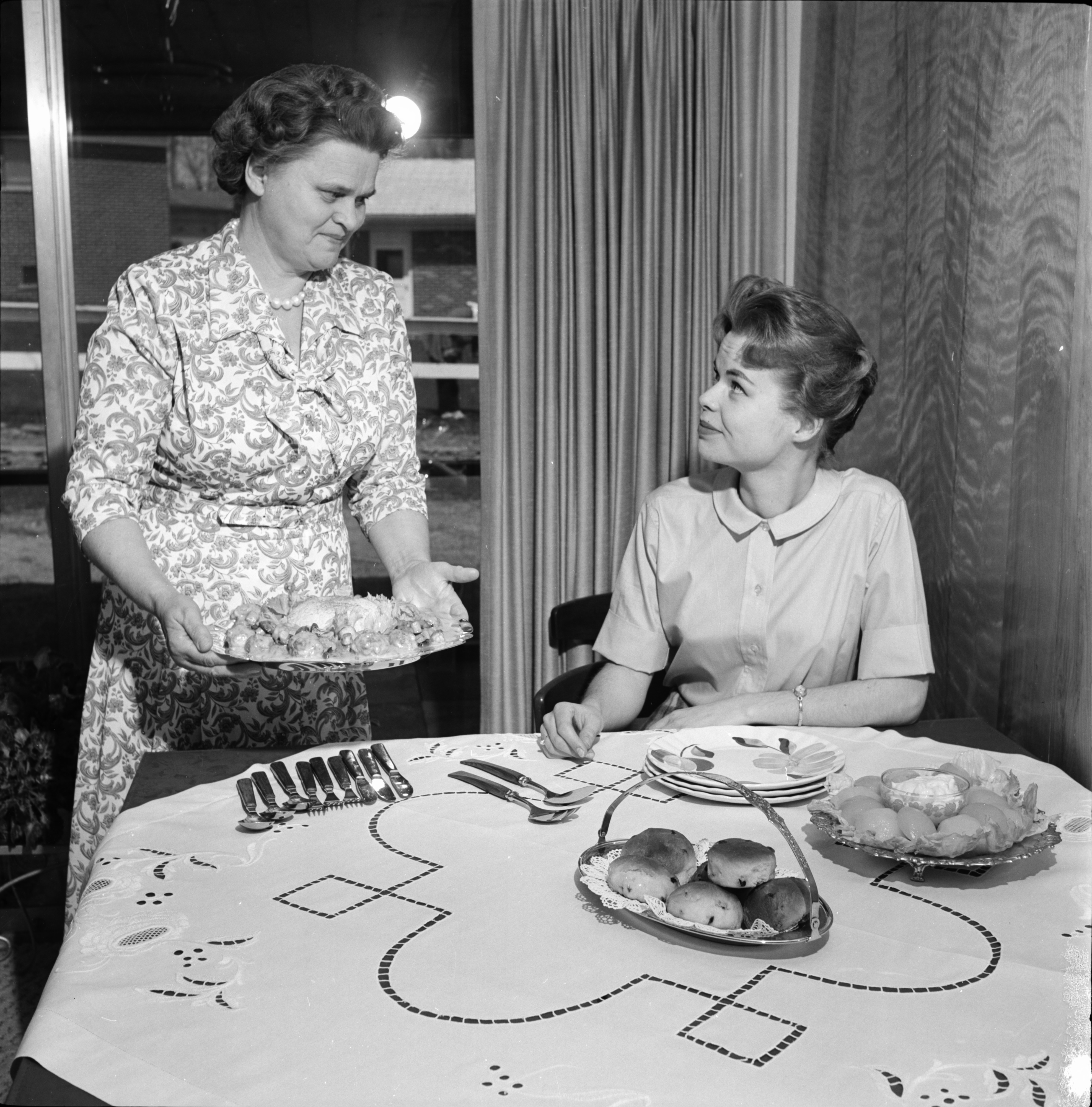 Image from Agnes T. Wangdahl Serves a Norwegian Meatball Dinner to Daughter Jane Marie, May 1962