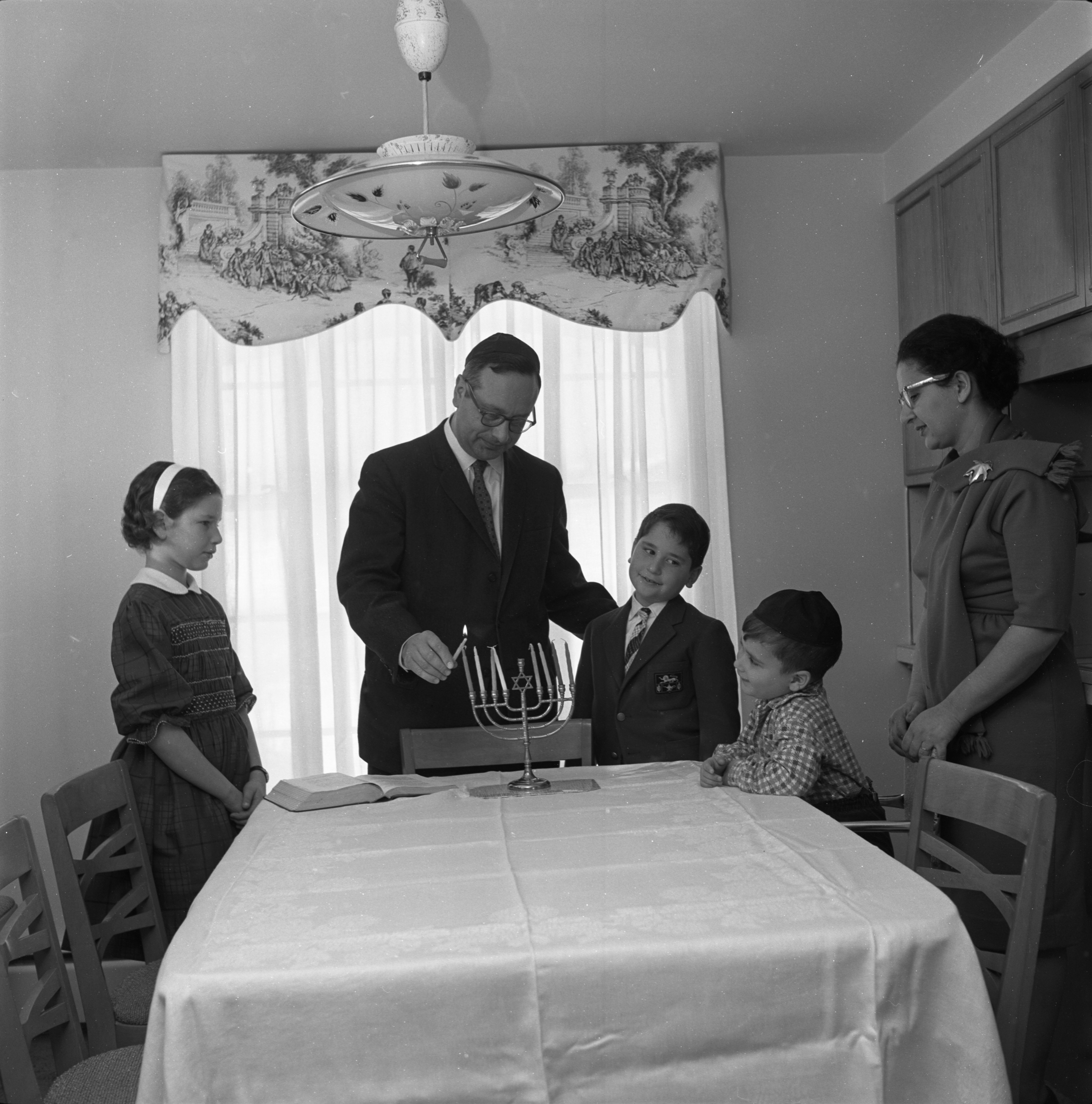 Pressell Family Celebrates The Beginning Of Hanukkah, December 1962 image