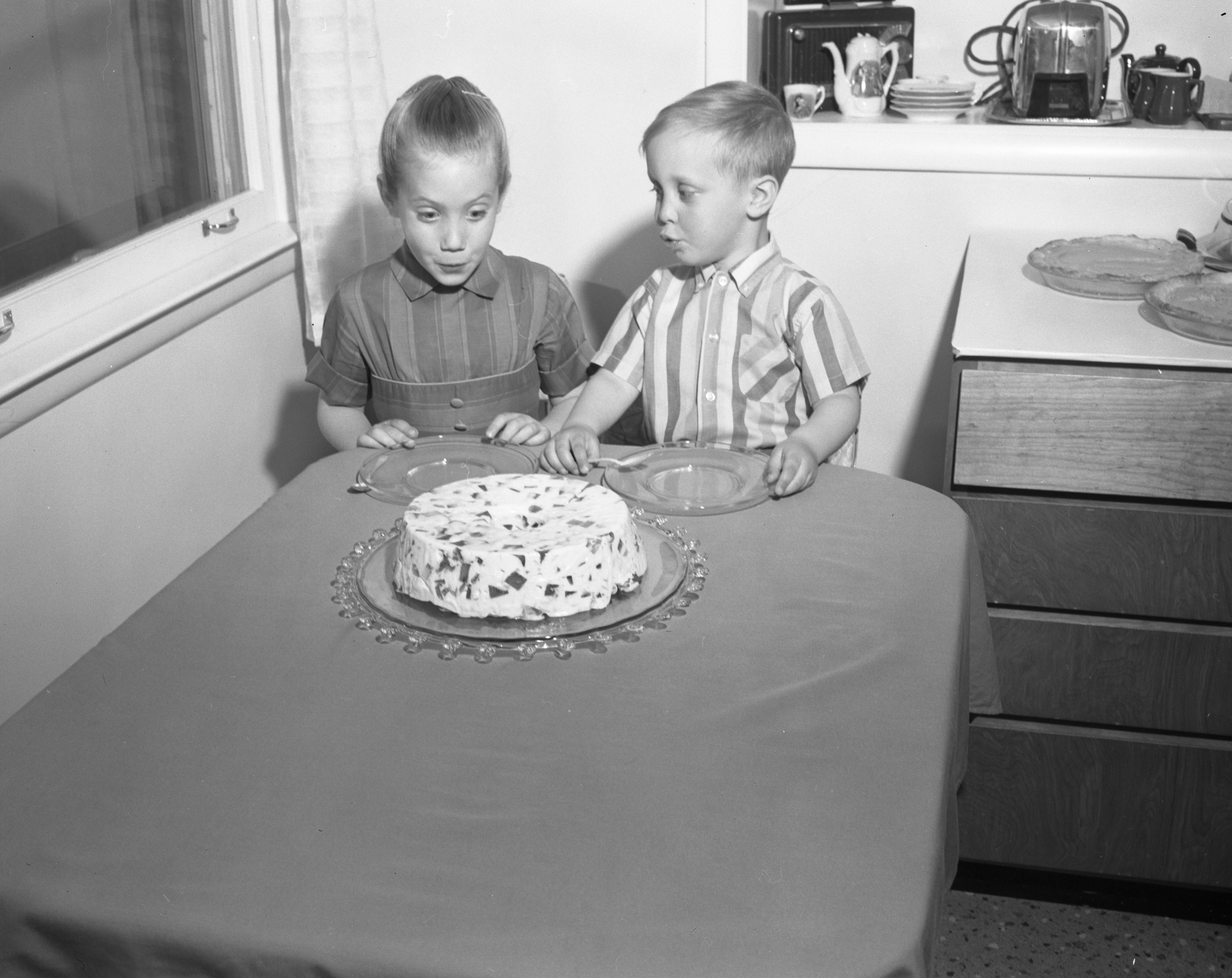 Peggy And Scott Hanley Wait For Dessert, May 1963 image
