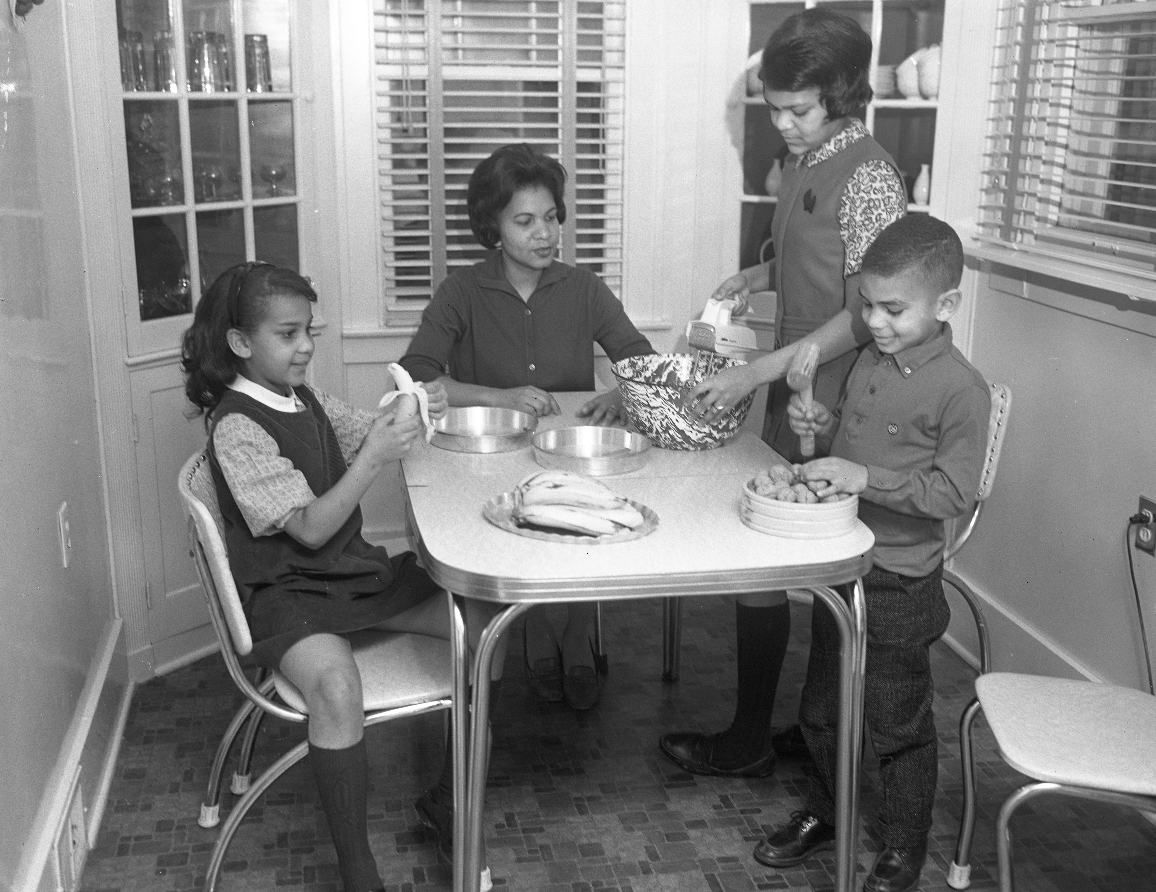 Gwendolyn Baker Makes Banana Cake with Children Claudia, Jo Ann and Jimmy, December 1963 image