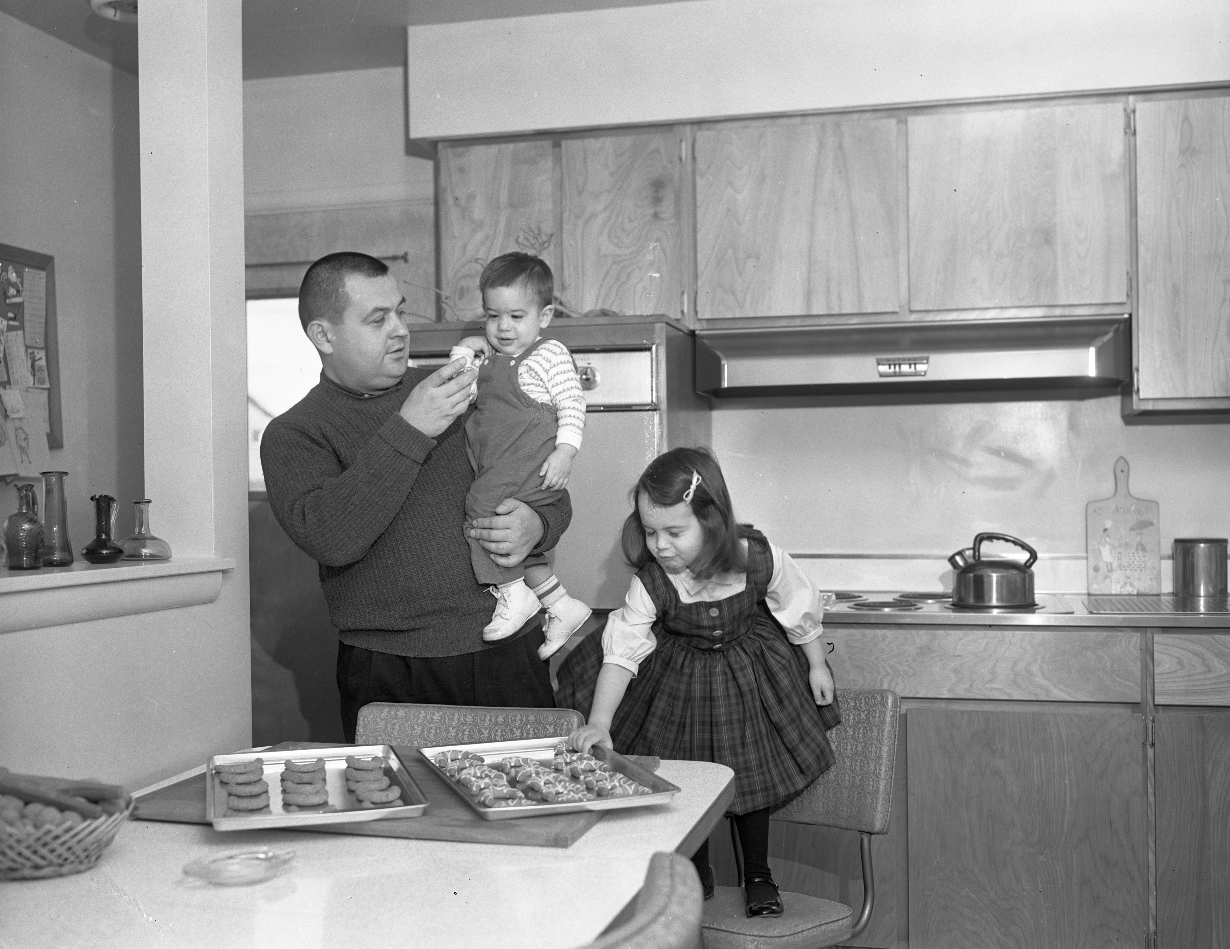 Milan Marich and Children David and Leslie make Serbian cookies, December 1963 image