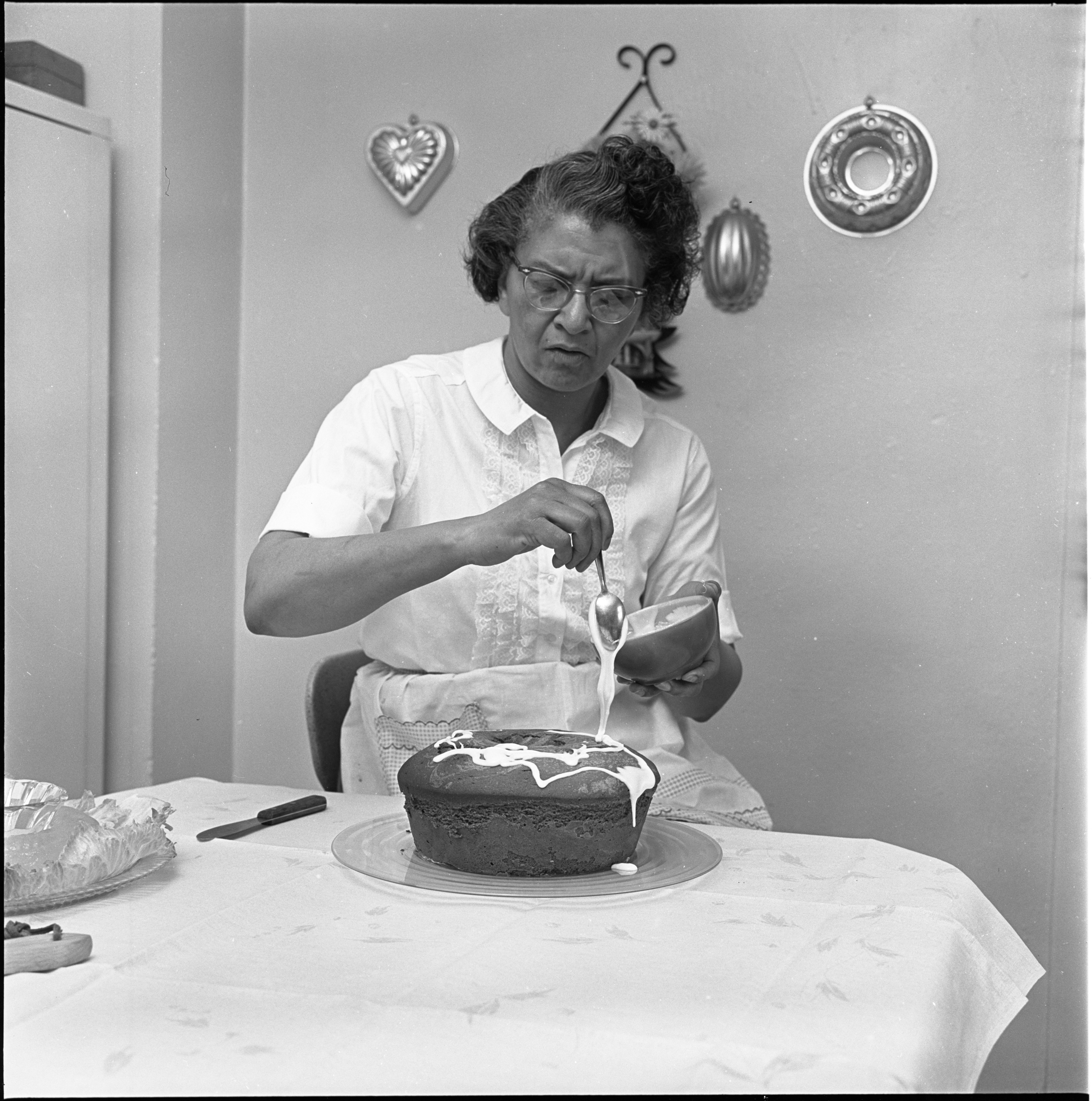 Helen Arnold Drizzles Frosting On A Pound Cake, April 1970 image