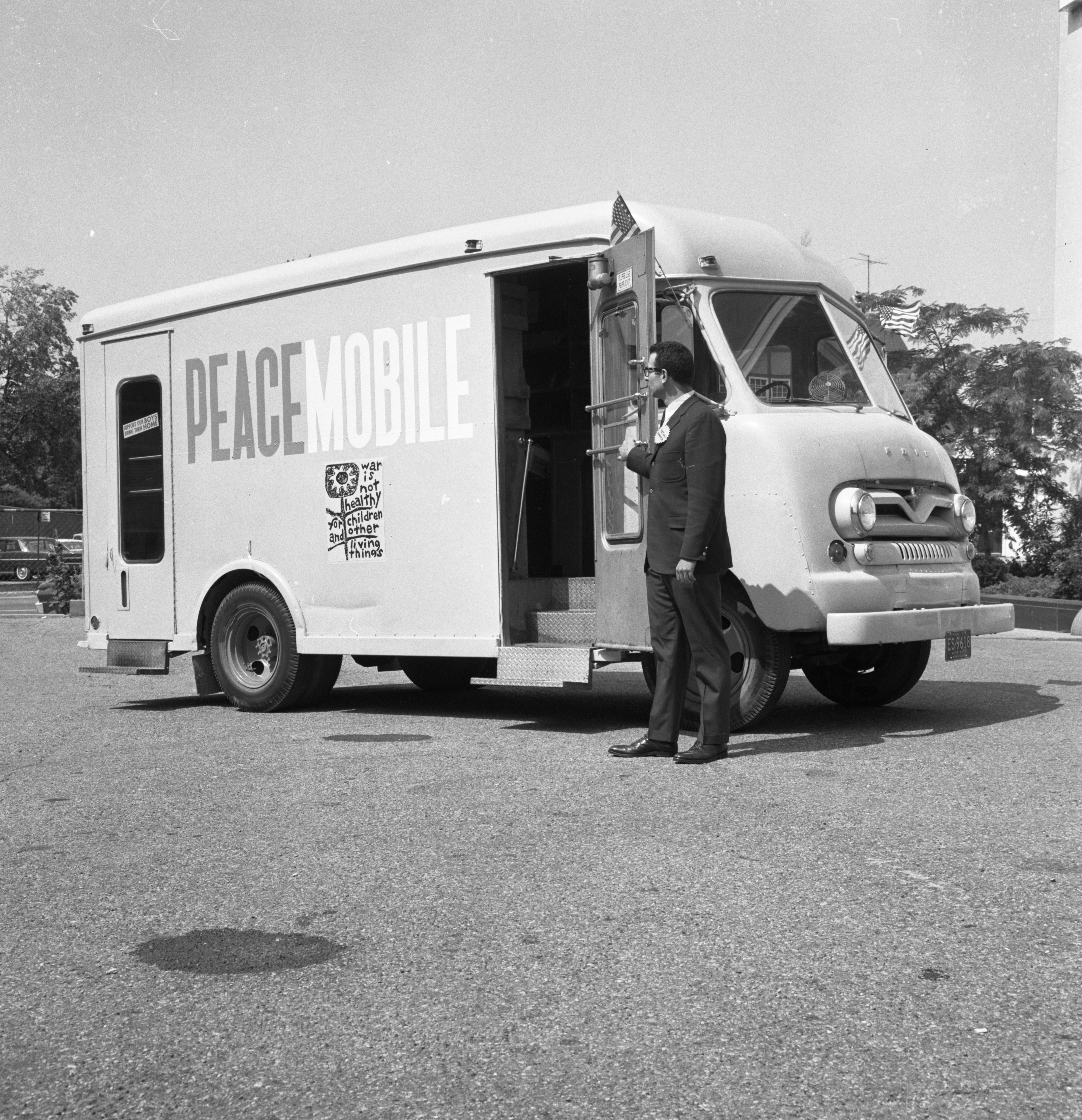 William R. Chilton poses next to the Peacemobile, July 1967 image