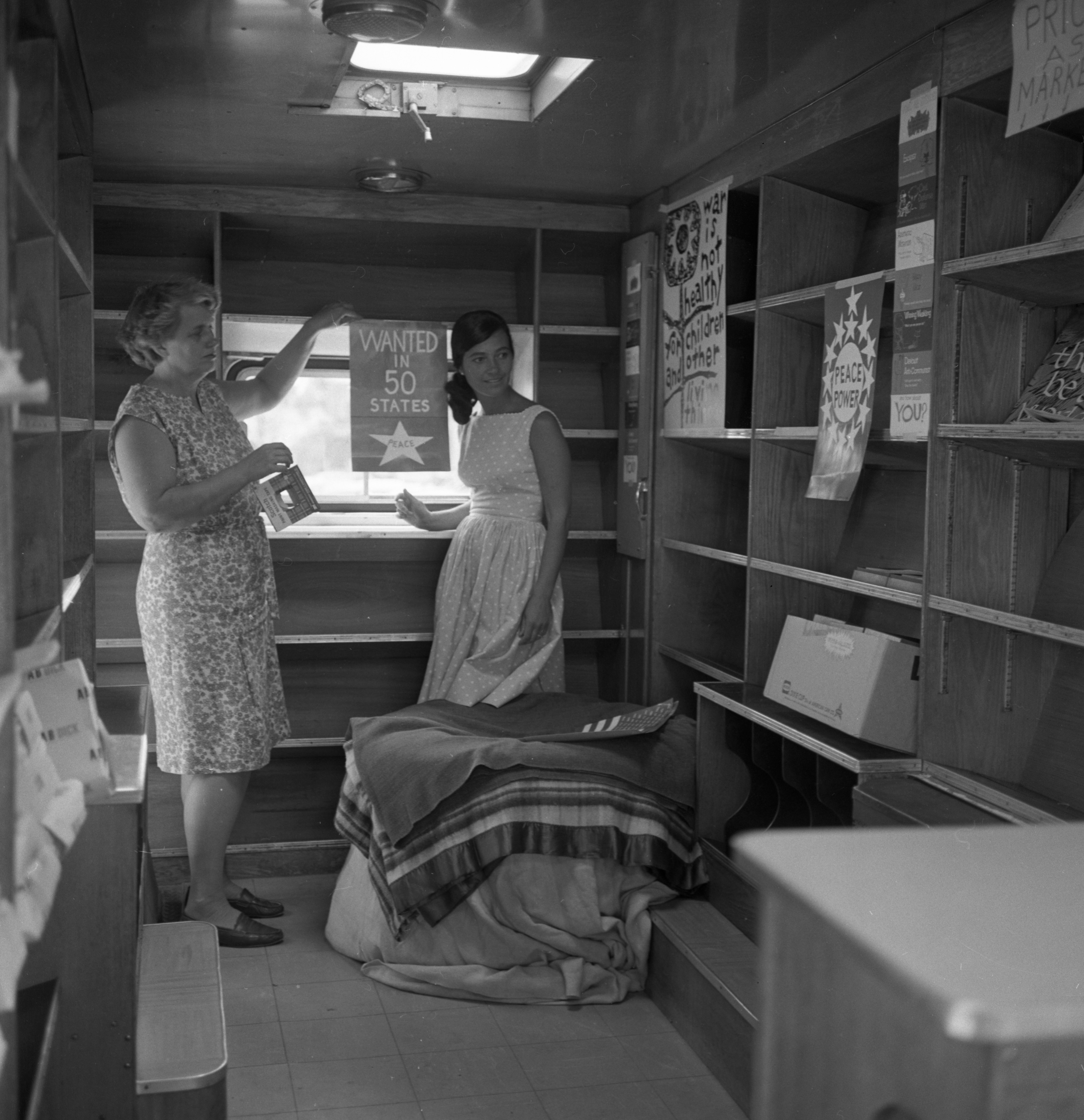 Mrs. Lewis B. Kellum and Mrs. Andrew Zweifler inside the Peacemobile, July 1967 image