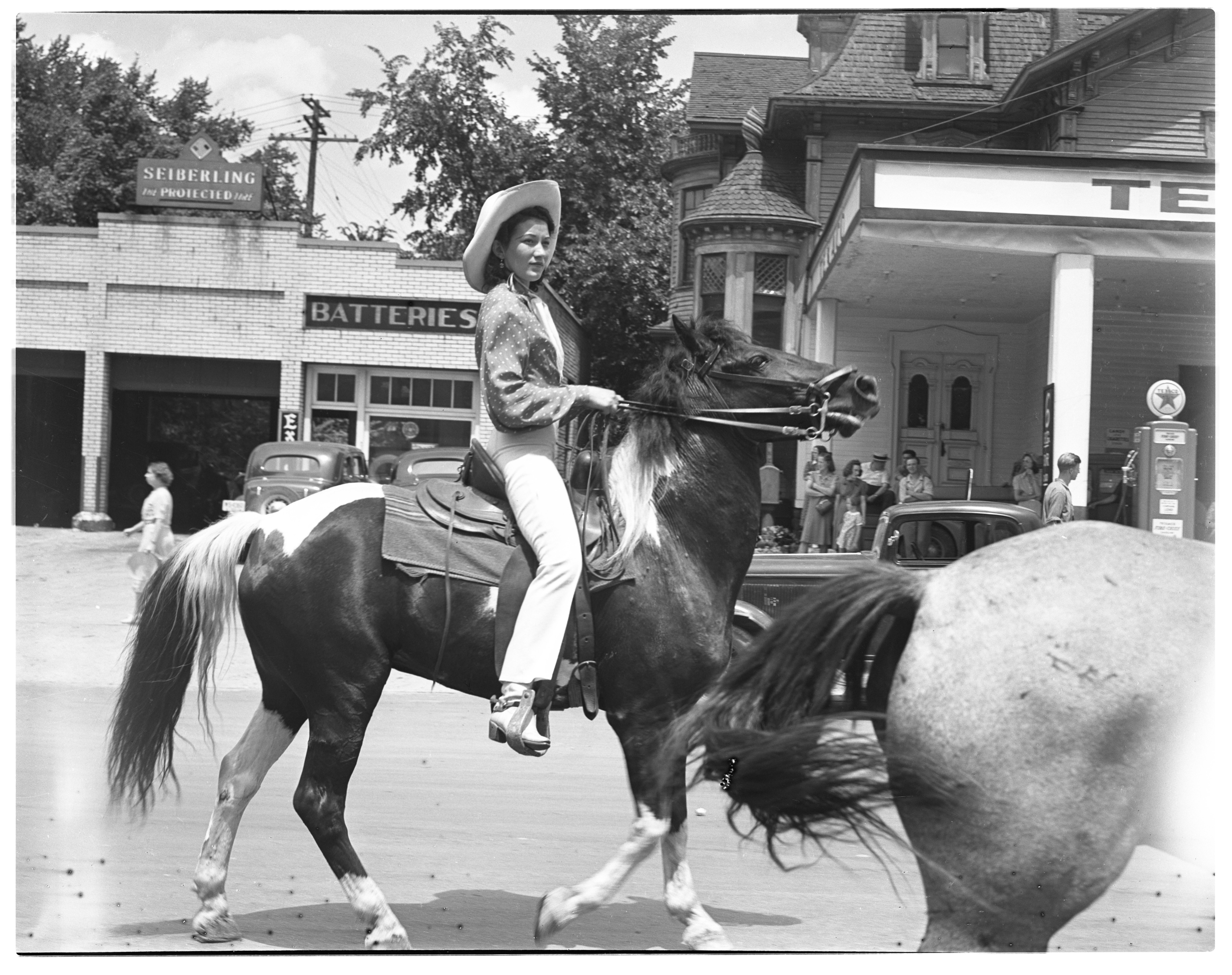 Parker & Watts Circus Parade - Horse and Rider Pass Texaco Station image