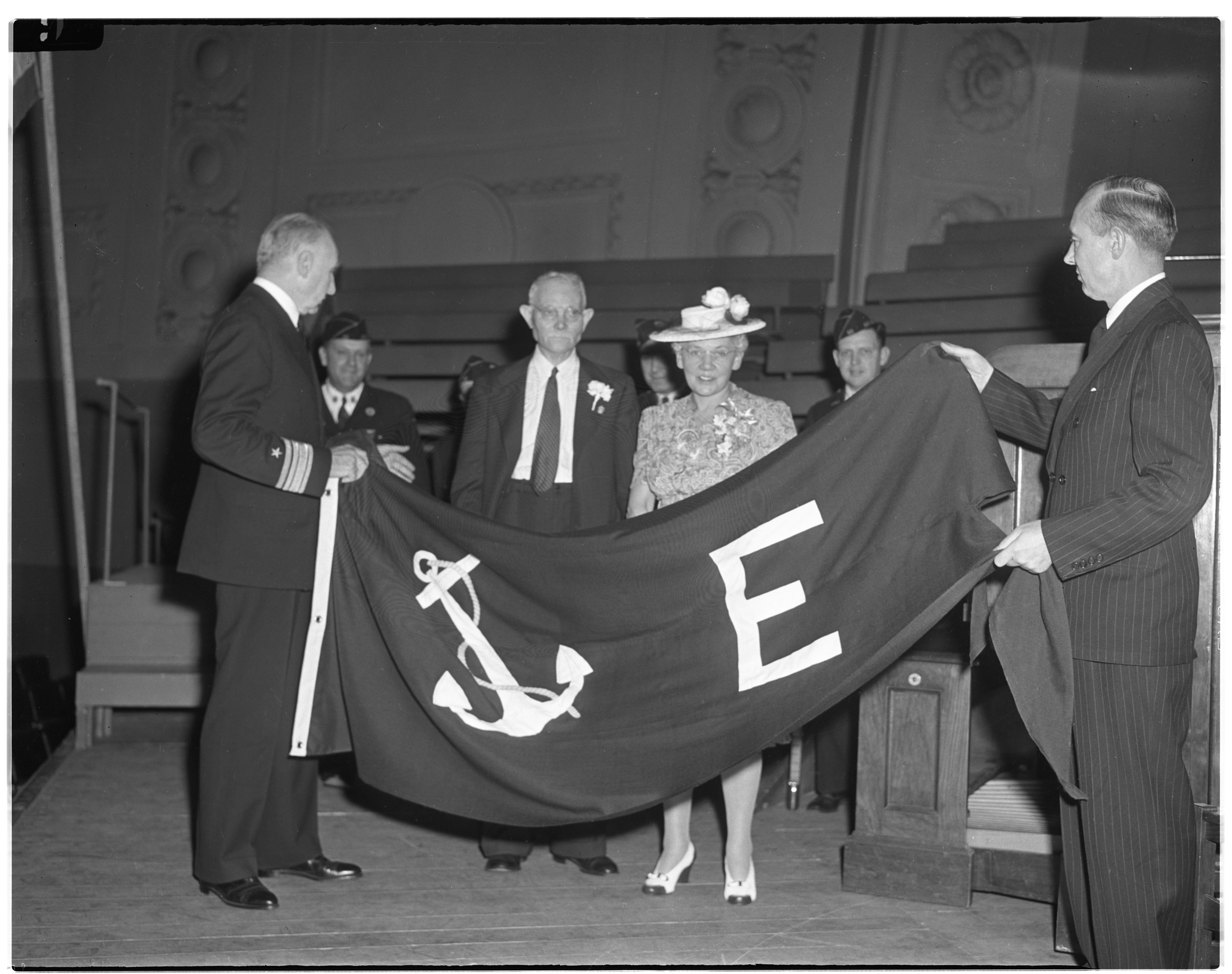King-Seeley Corp. receives the Navy 'E' for excellence pennant from Rear-Admiral William Carleton Watts, United States Navy. image
