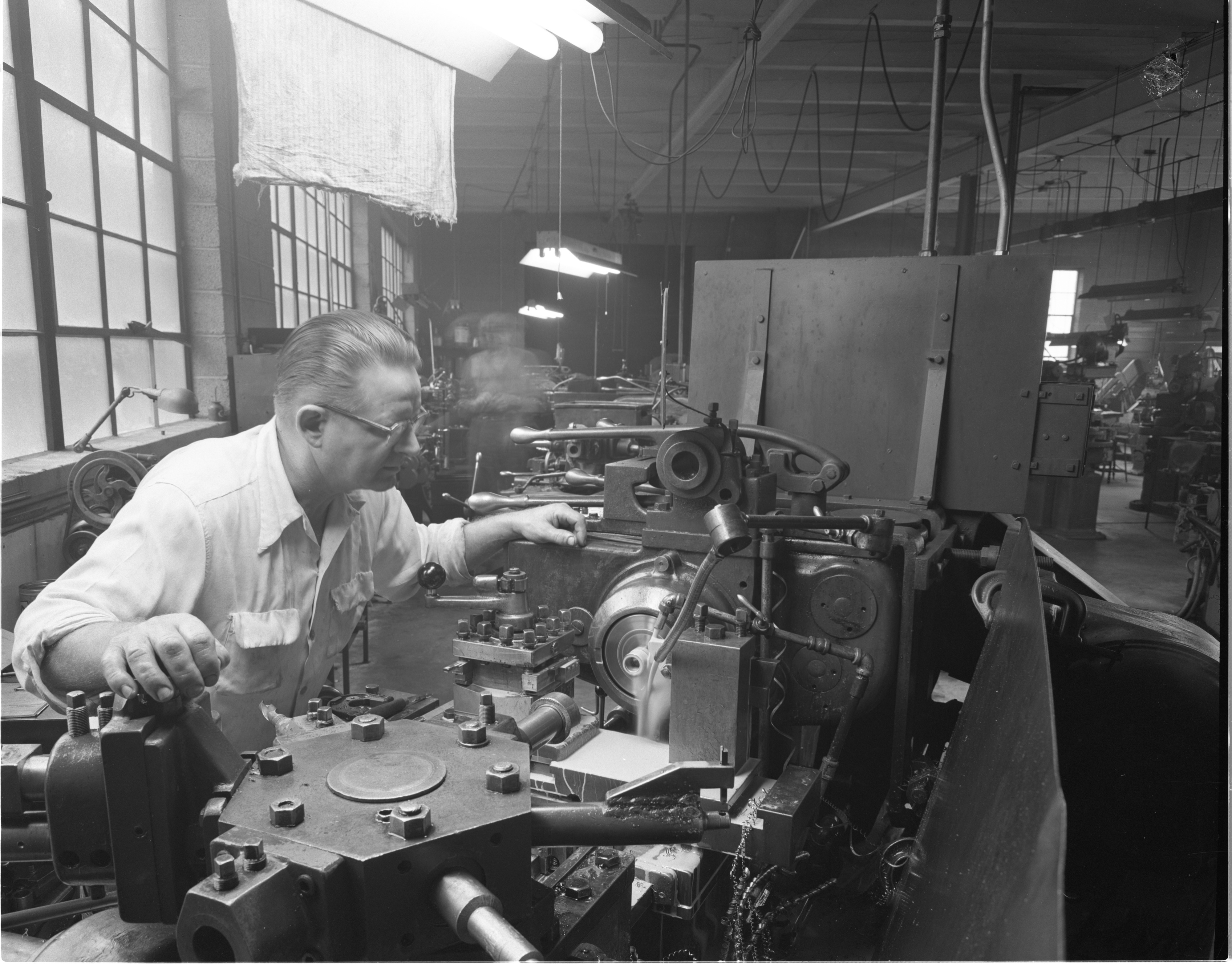 Arthur Bauer Operates A Turret Lathe At The Morton Bearing Company, December 1954 image
