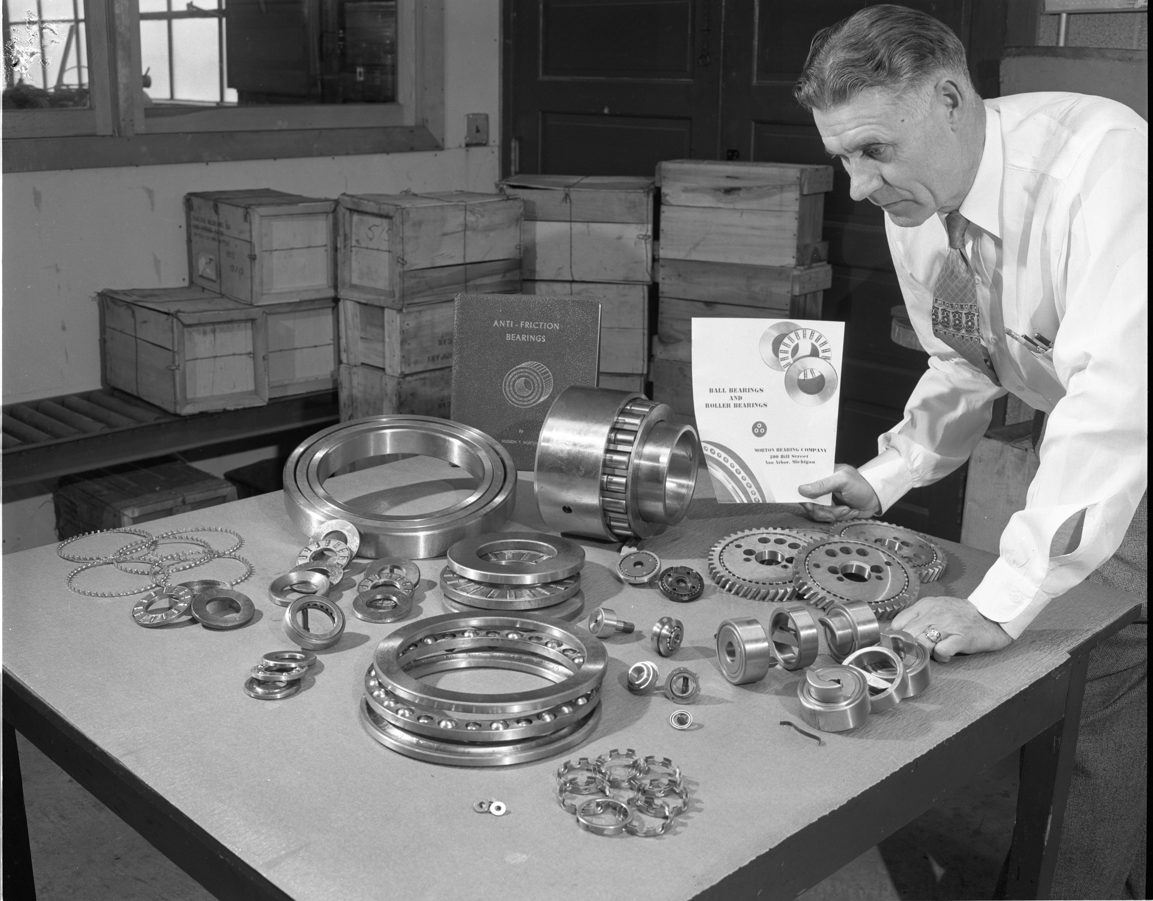 Hudson T. Morton Examines Bearings Manufactured At The Morton Bearing Company, December 1954 image