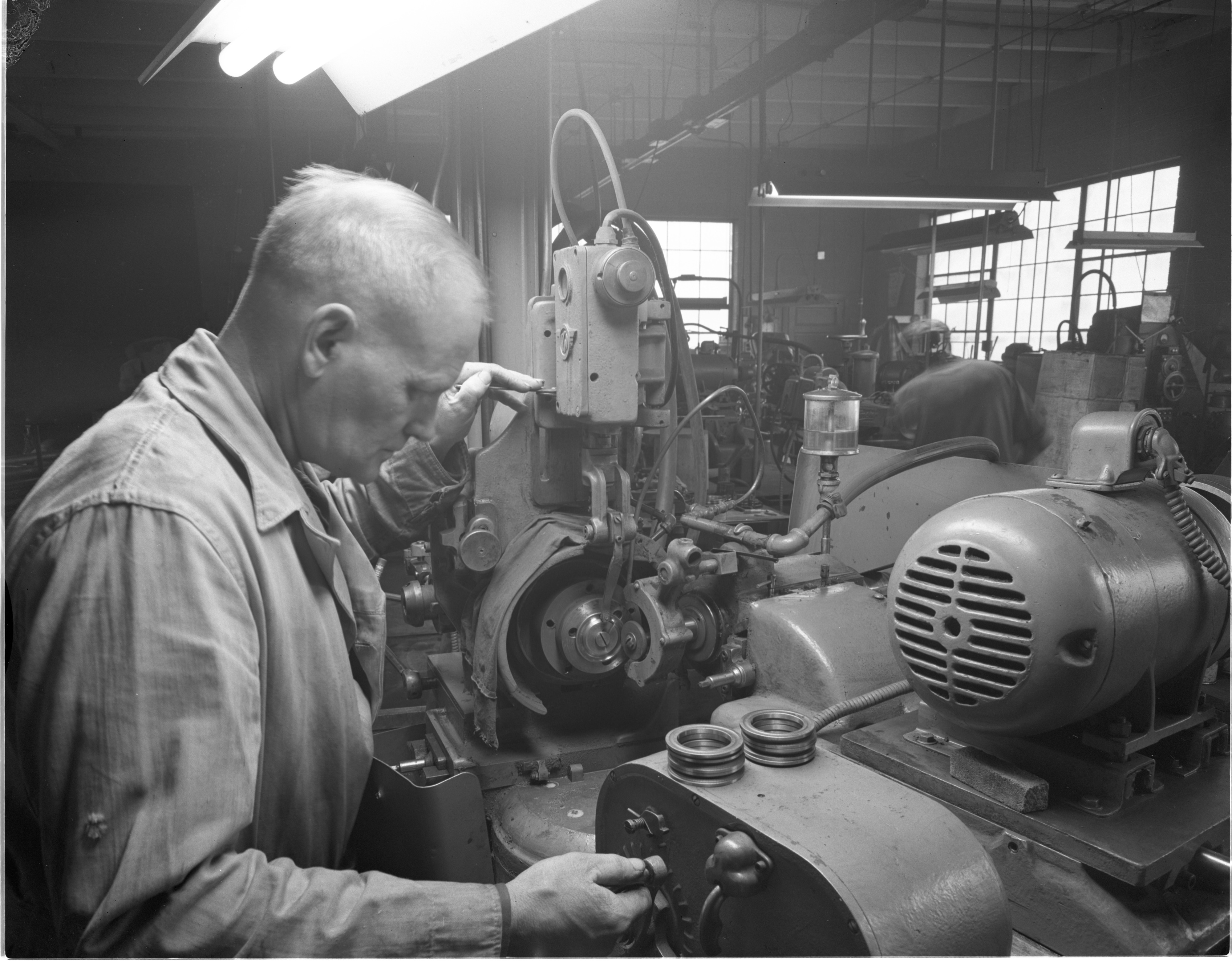 Clyde Hudson Grinds Bearings At The Morton Bearing Company, December 1954 image