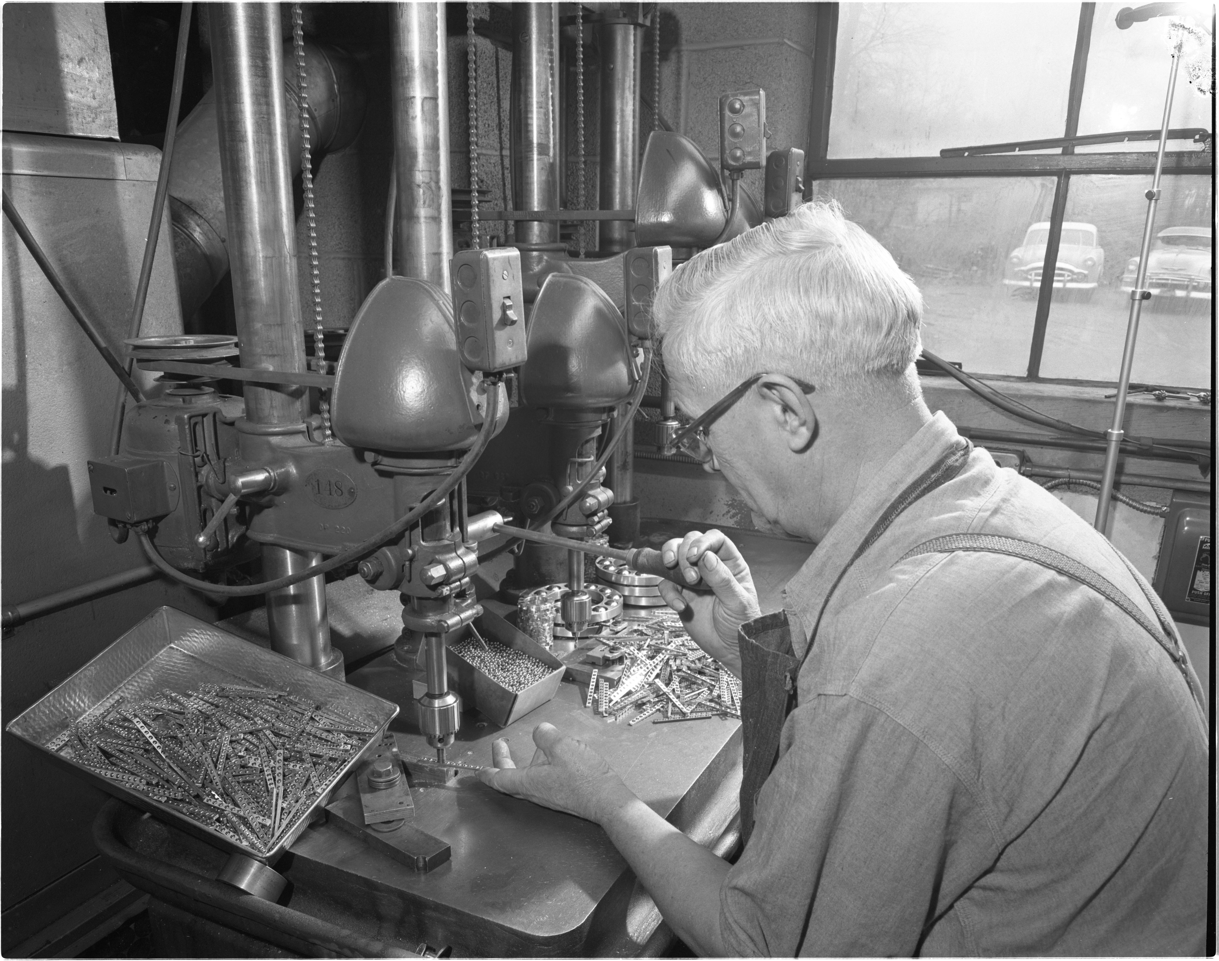 Henry Heinzman Operates A Press Machine At The Morton Bearing Company, December 1954 image