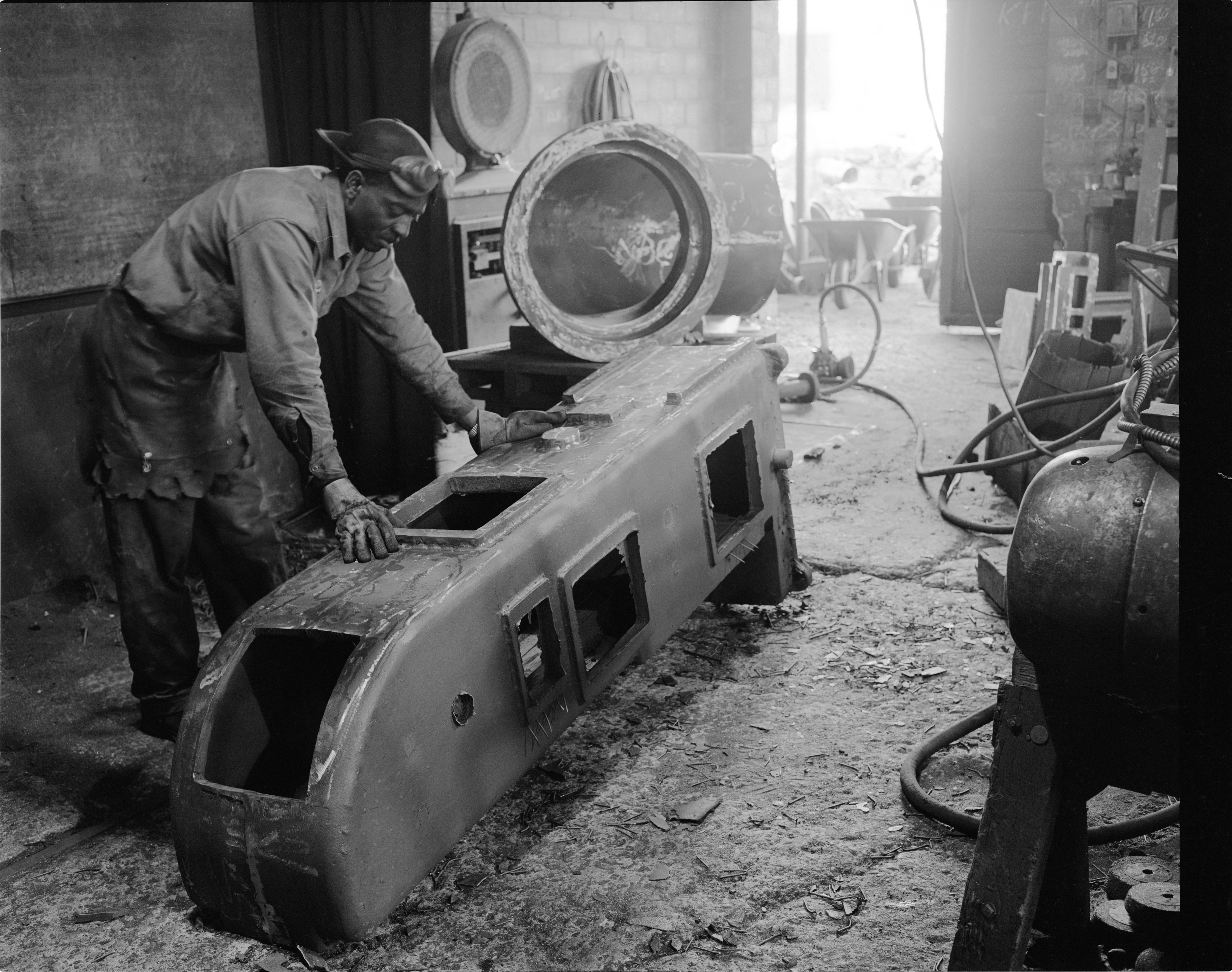 Dave Drumright Inspects Machinery At The Ann Arbor Foundry, February 1954 image