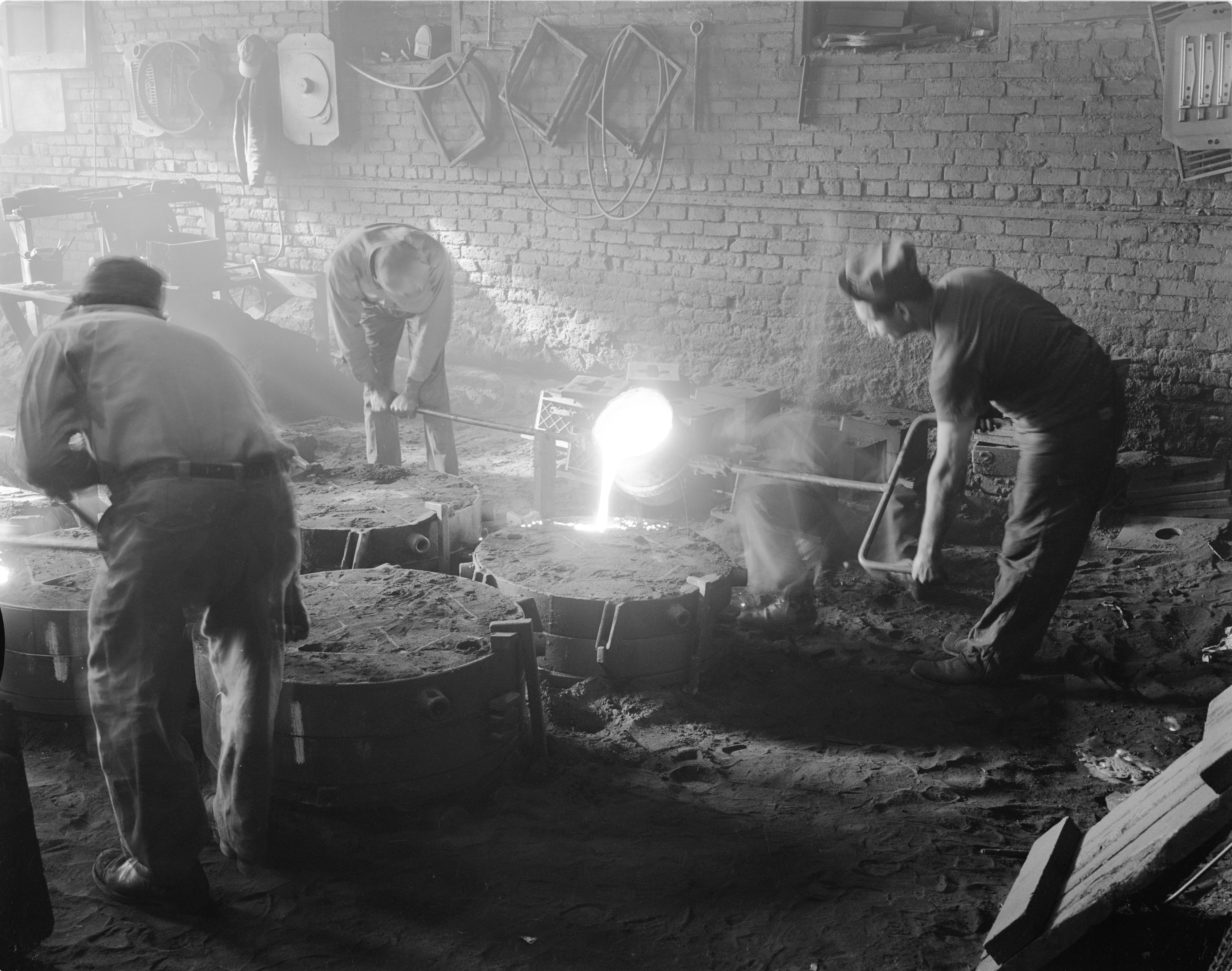 Workers Pour Molten Iron Into A Form At The Ann Arbor Foundry, February 1954 image