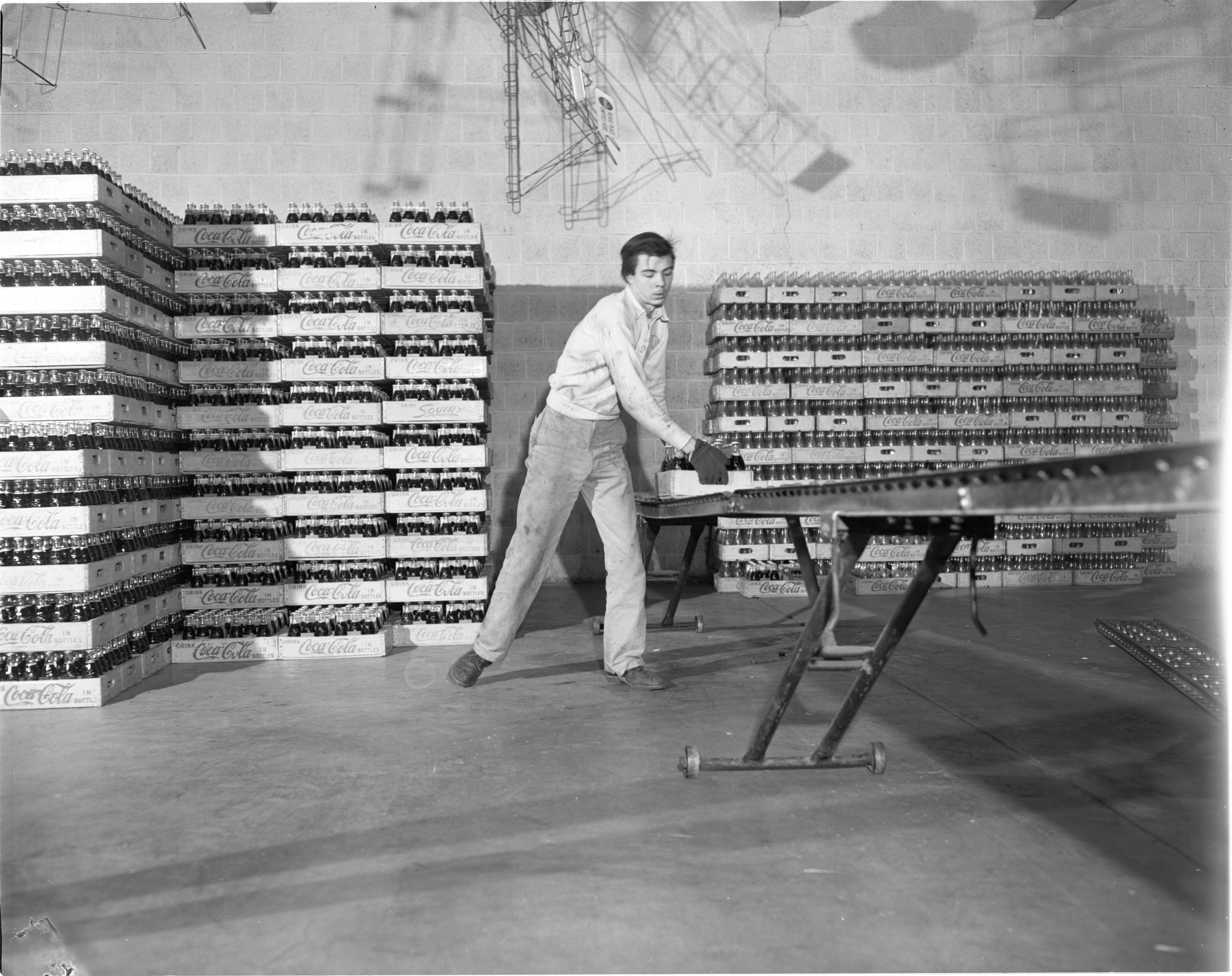Cases Of Freshly Bottled Coca-Cola Are Removed From The Line At The Kleis Beverage Co., January 1956 image