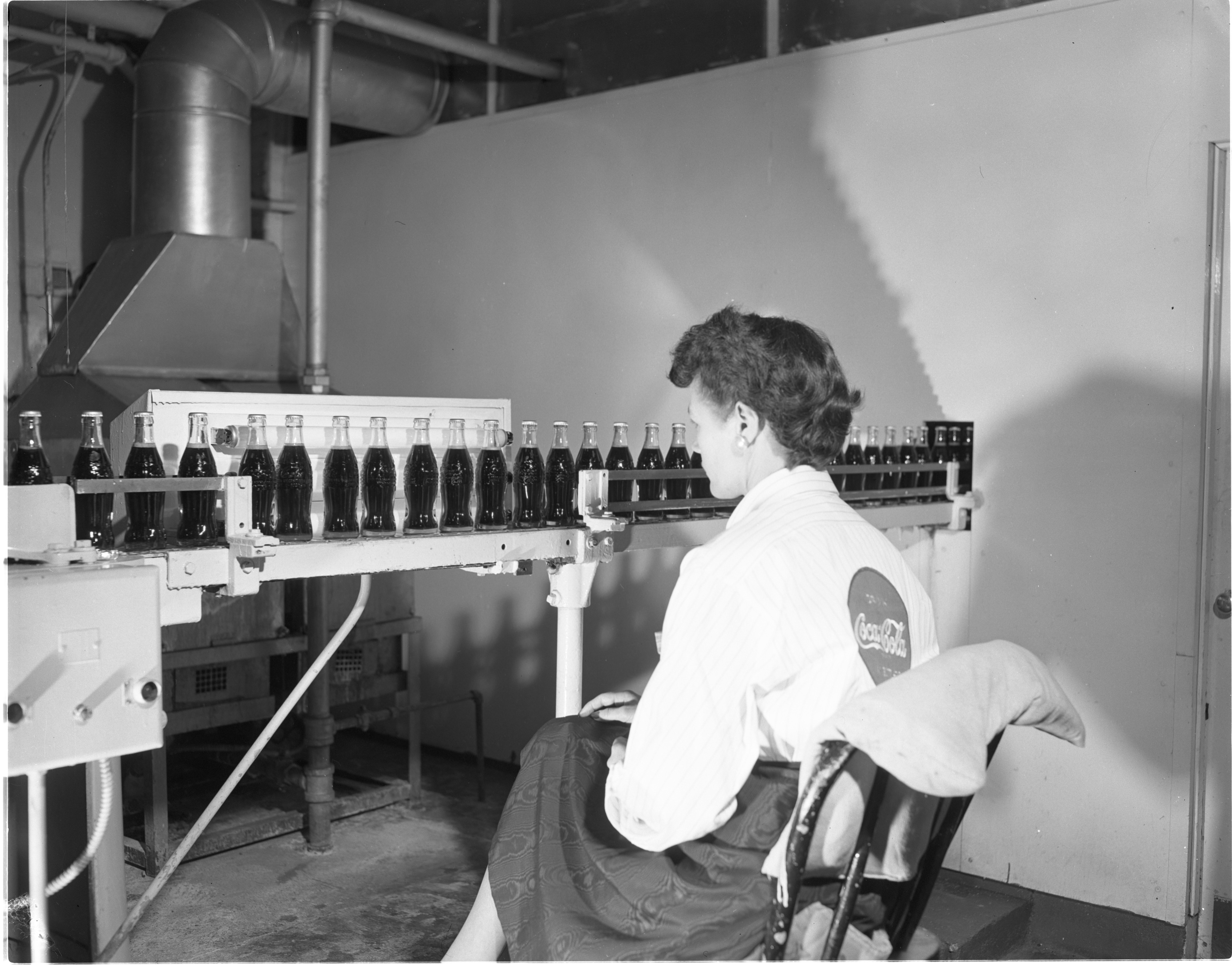 Freshly Bottled Coca-Cola Is Inspected At The Kleis Beverage Co., January 1956 image