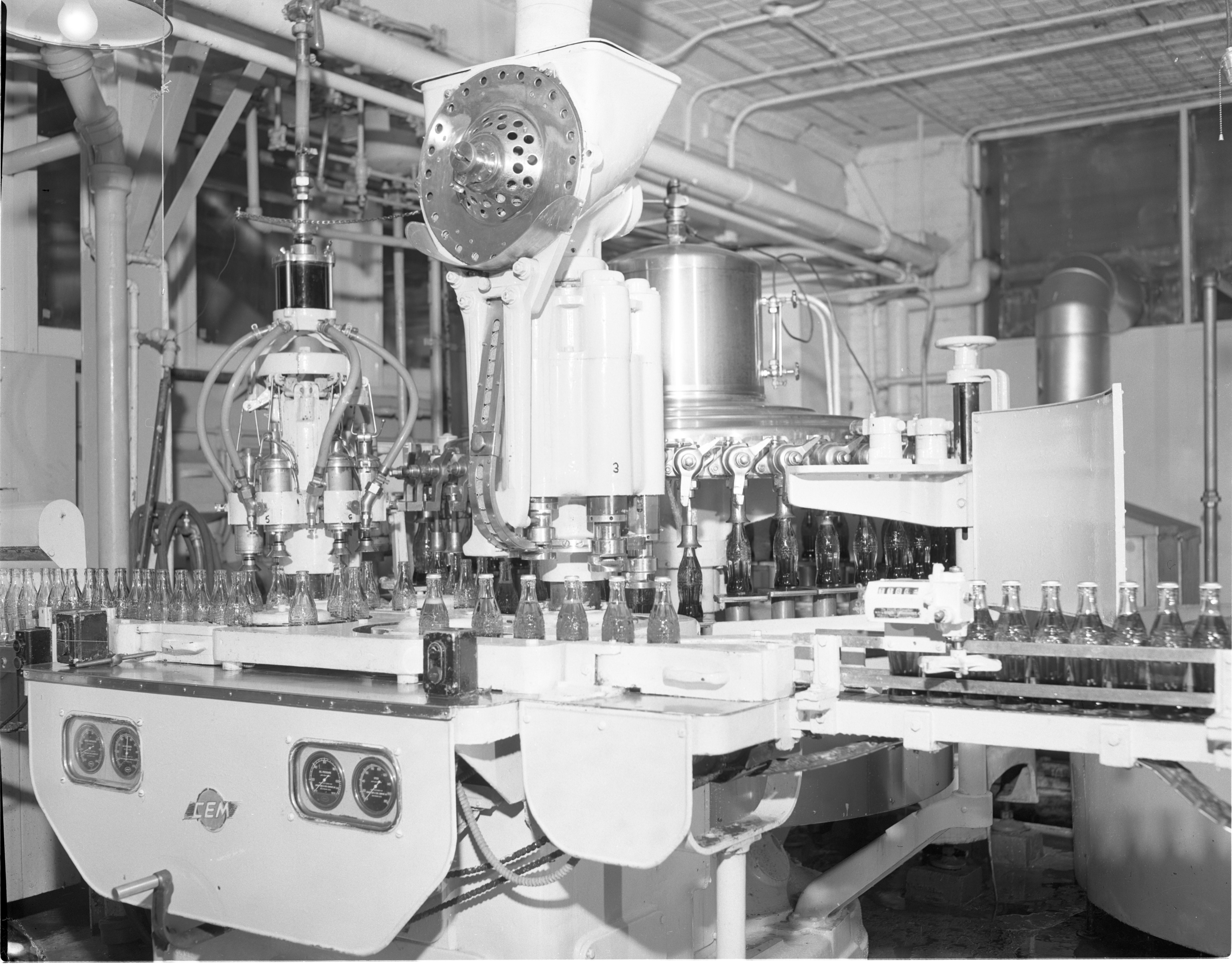 Coca-Cola Bottles Are Filled By A Machine At The Kleis Beverage Co., January 1956 image