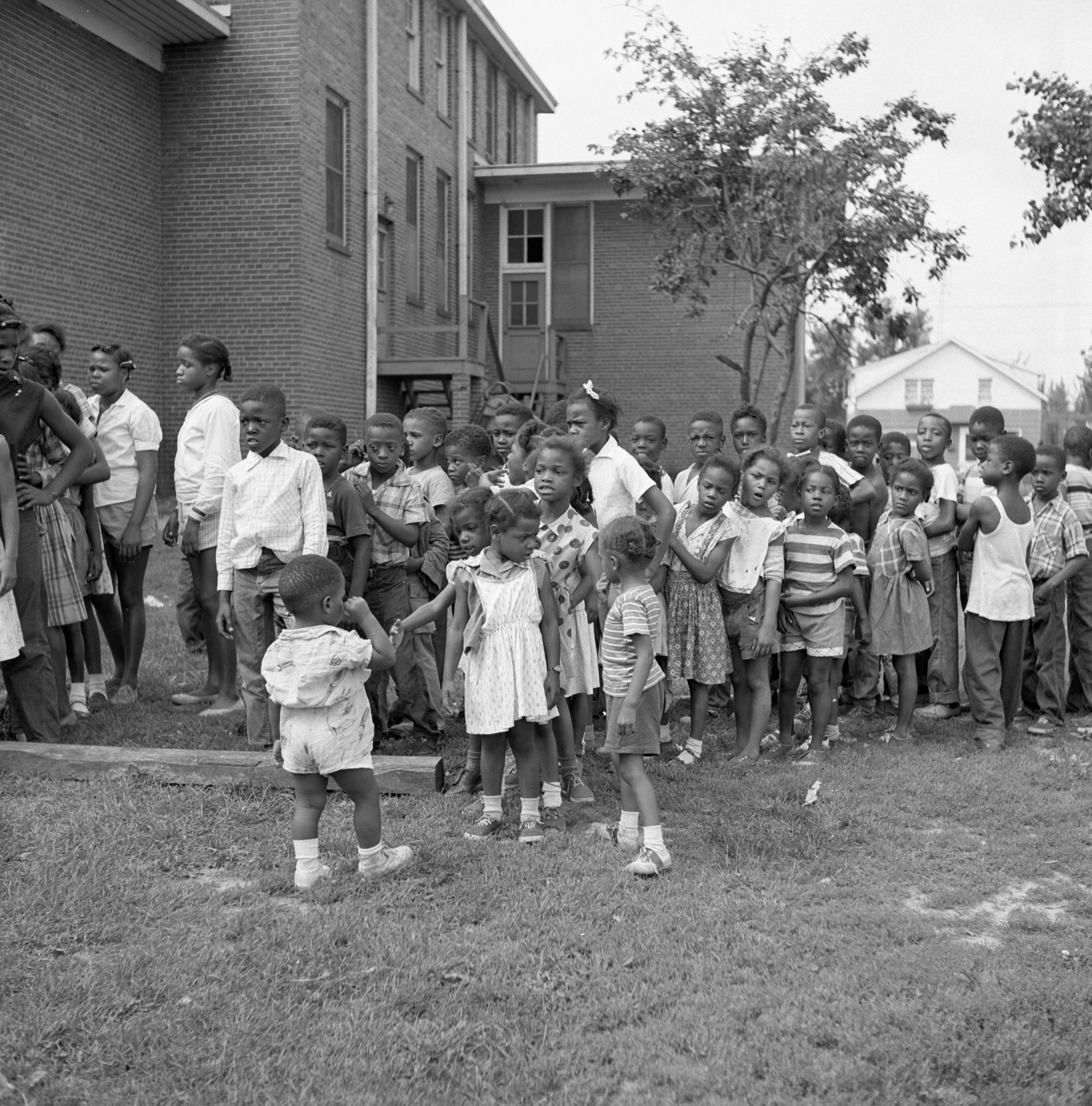 Children Gather For Public Preview Of Pump-O-Matic Merry-Go-Round At Parkridge Community Center, August 1956 image
