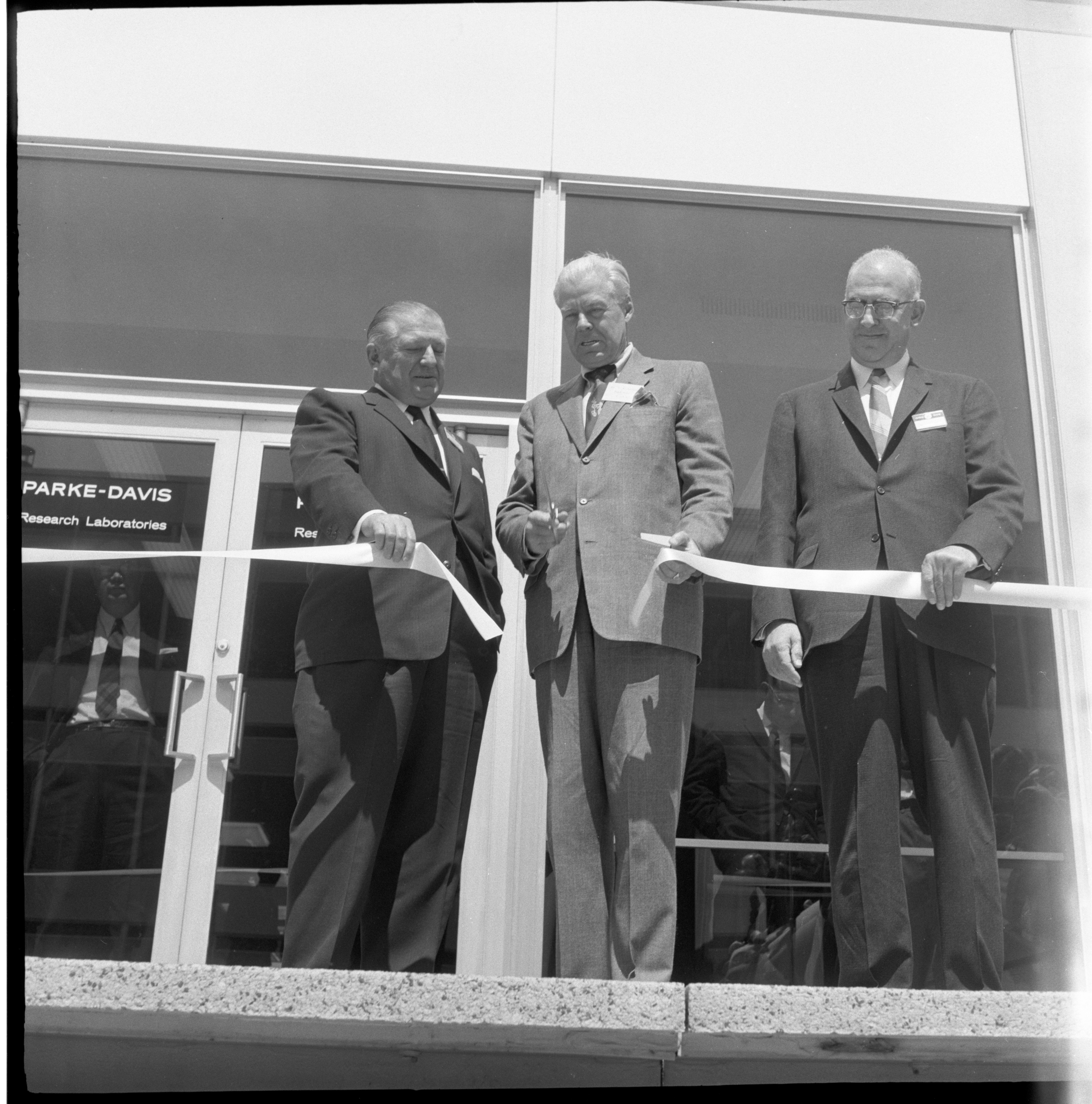 Harlan Hatcher Cuts The Ribbon At The Formal Opening & Dedication Of The New Ann Arbor Parke Davis Research Laboratories, April 1960 image