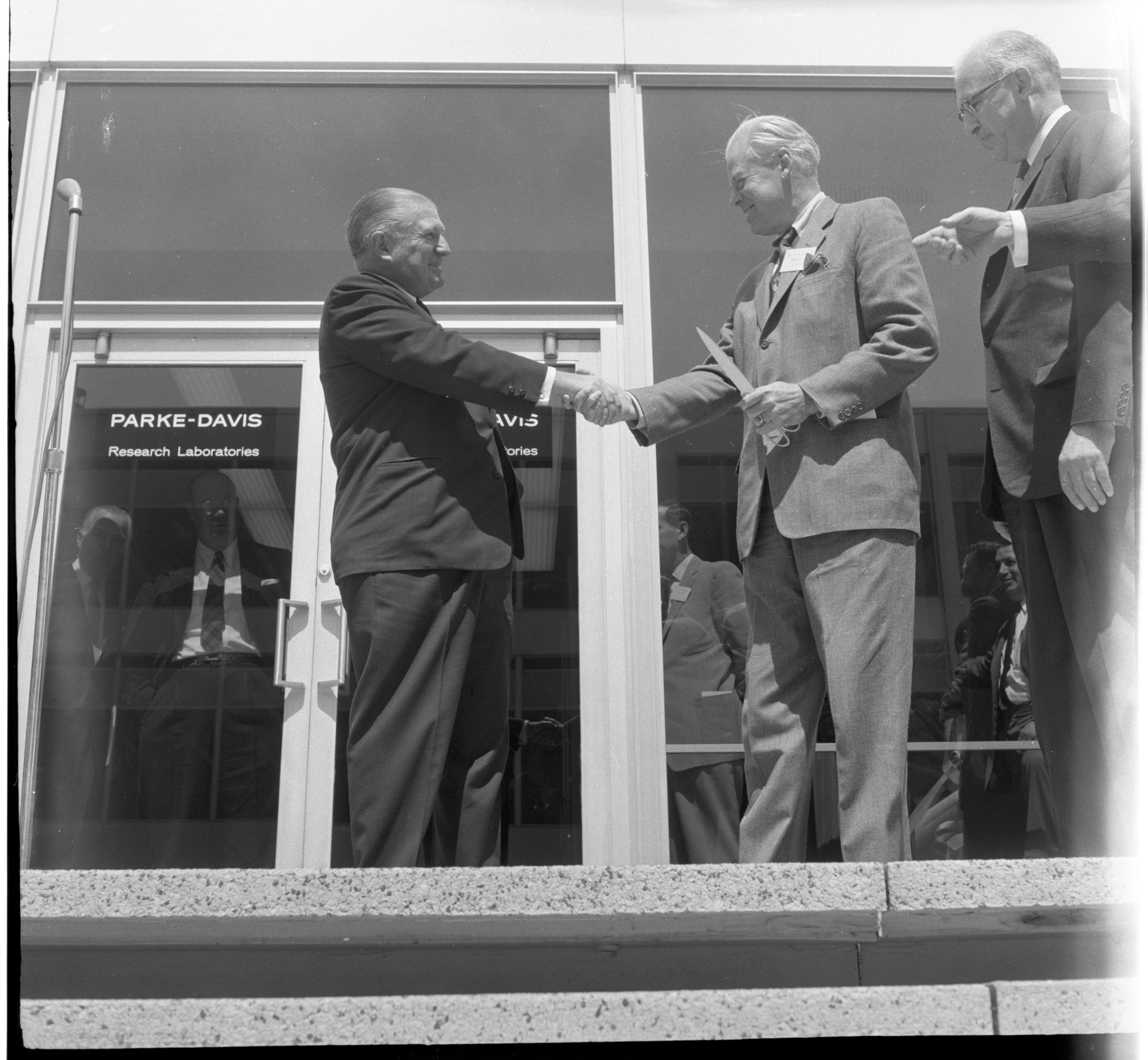 Harry Loynd Shakes Hands With Harlan Hatcher At The Formal Opening & Dedication Of The New Ann Arbor Parke Davis Research Laboratories, April 1960 image