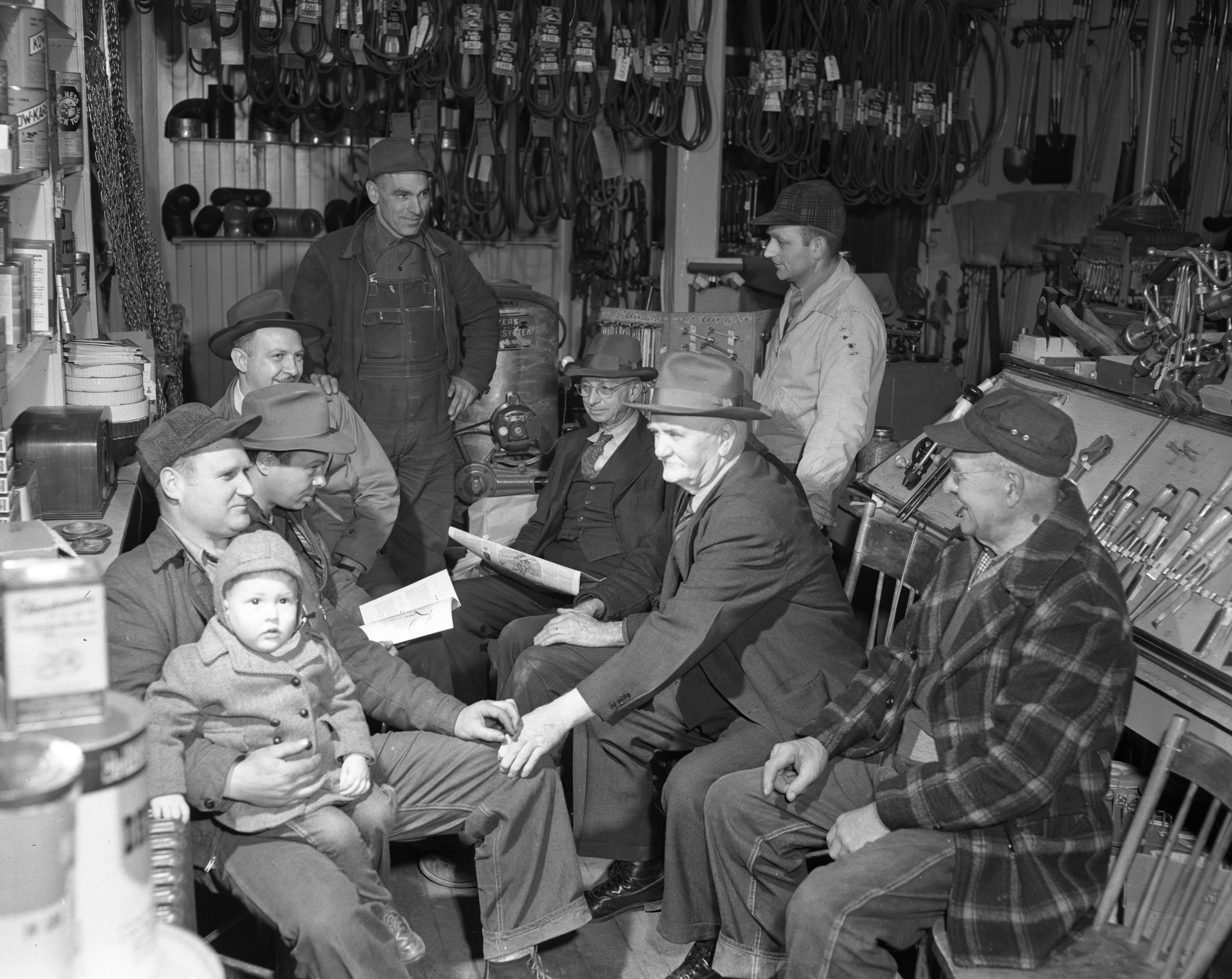 Farmers around the stove at Hertler Brother's Farm Store, March 1949 image