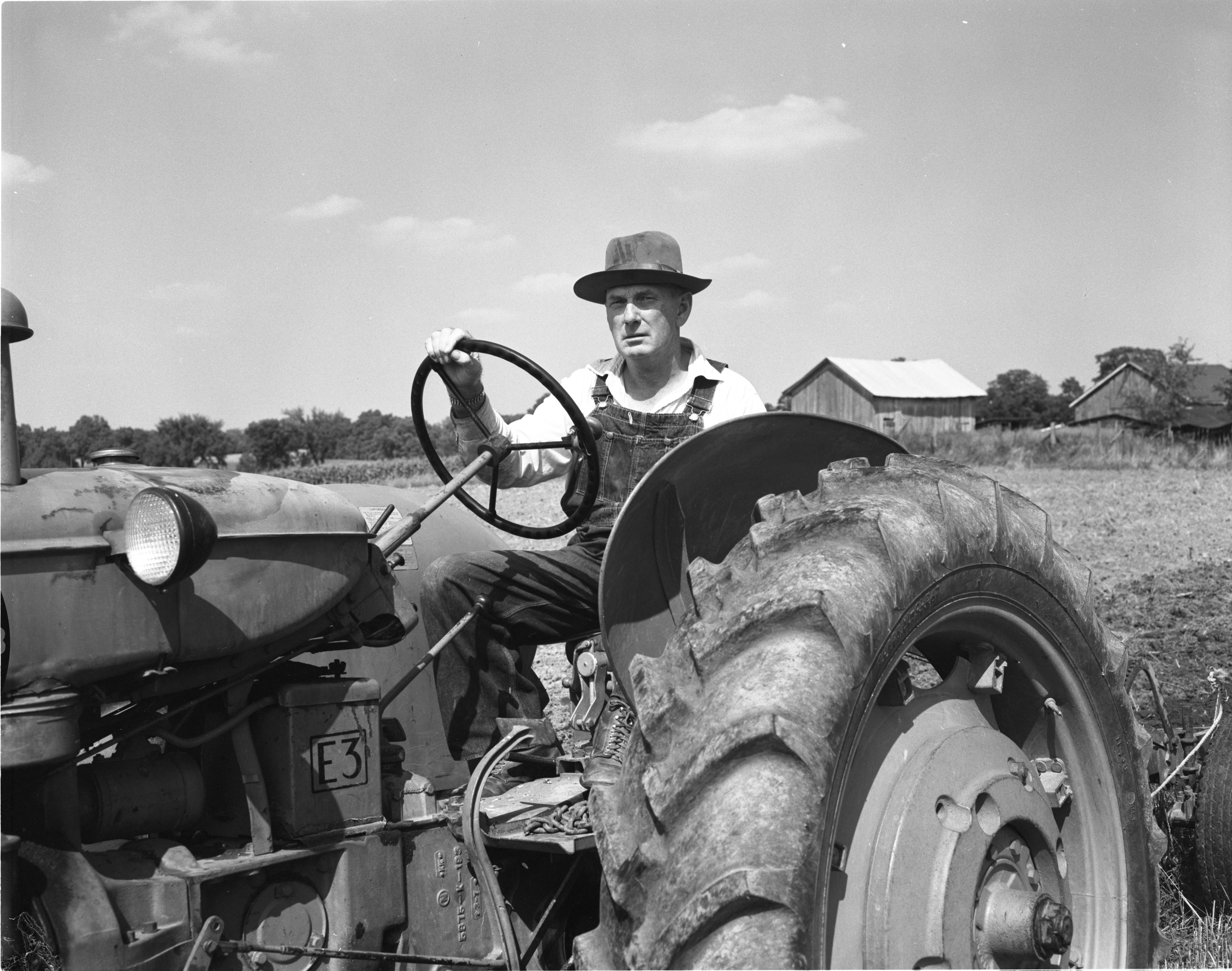 Emory Mulholland, Farmer & Superior Township Supervisor, On His Tractor, August 1956 image