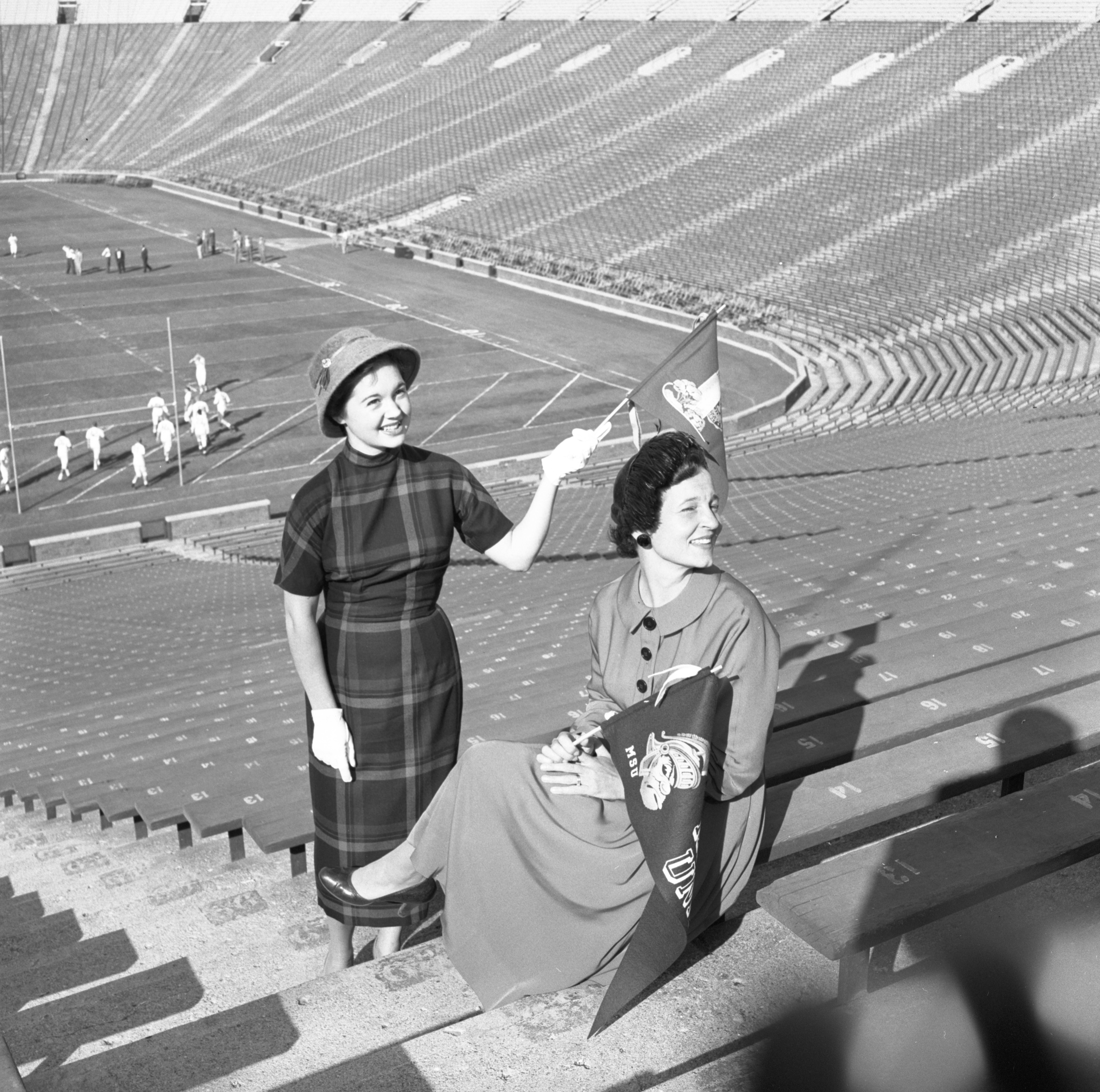 Mrs. Walter Stein & Marian Allmand Model Fall Fashions In Michigan Stadium, October 1956 image