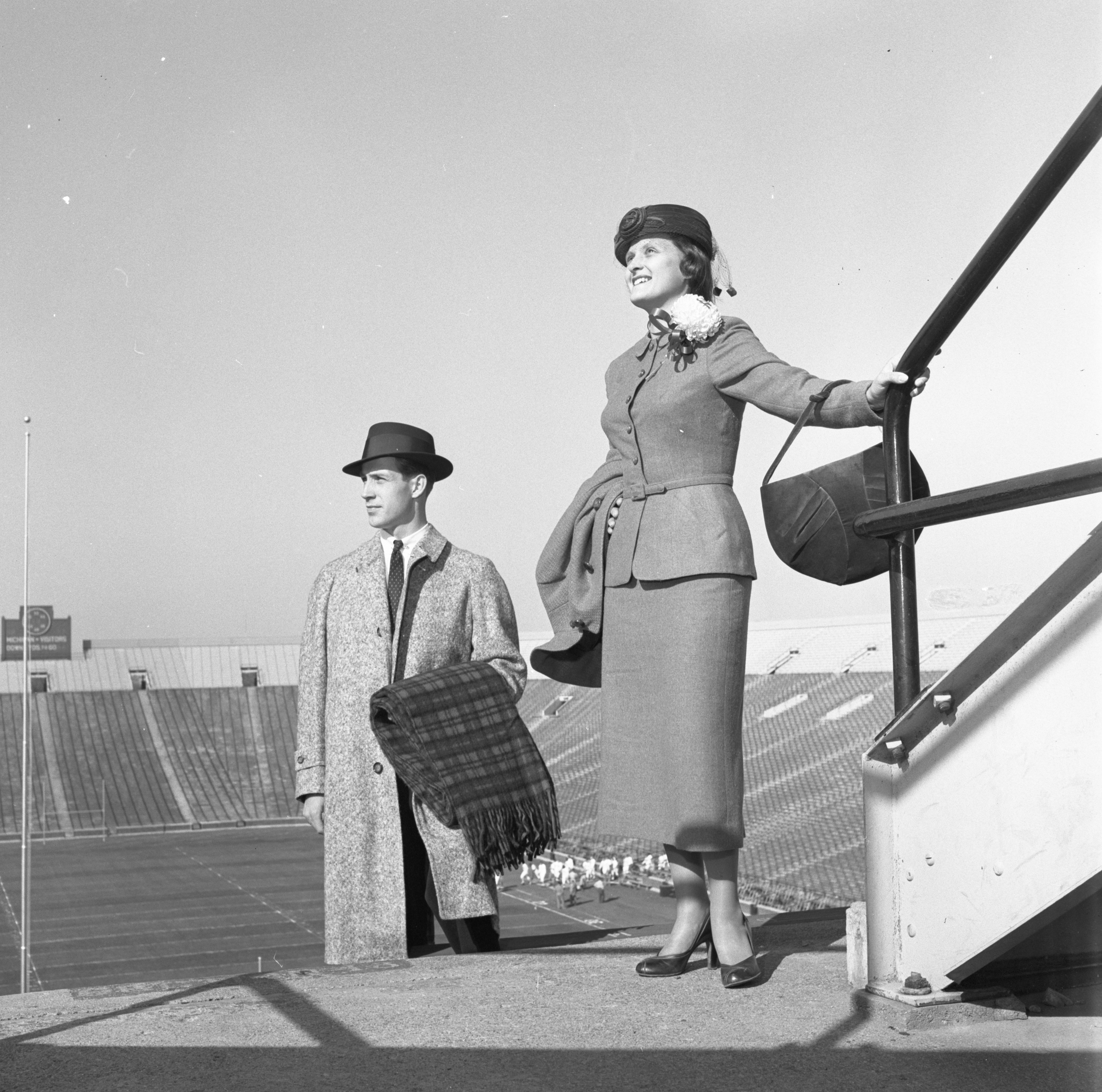 Robert Lemmon & Edith Dale Model Fall Fashions In Michigan Stadium, October 1956 image