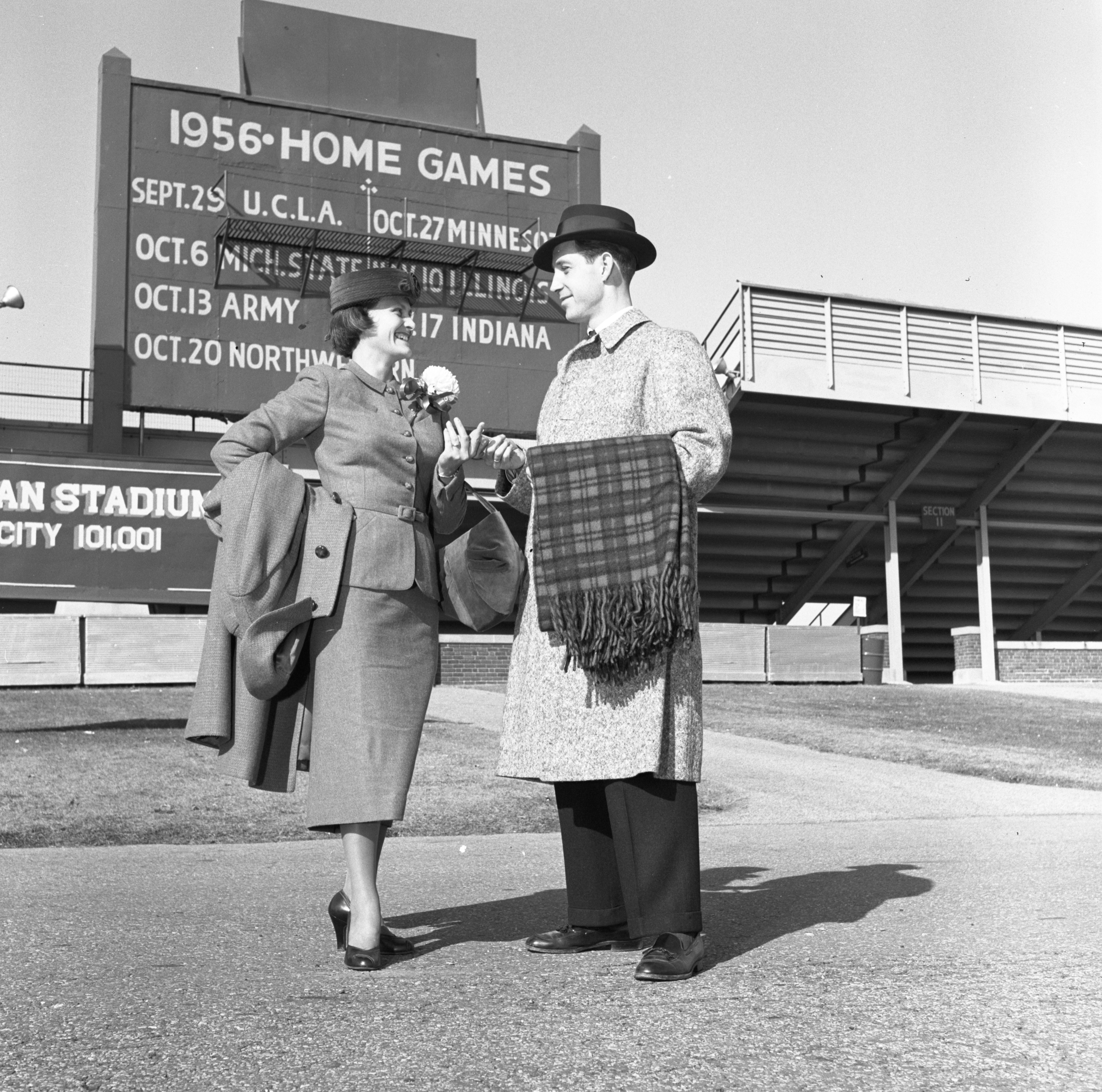 Robert Lemmon & Edith Dale Model Fall Fashions Outside Michigan Stadium, October 1956 image