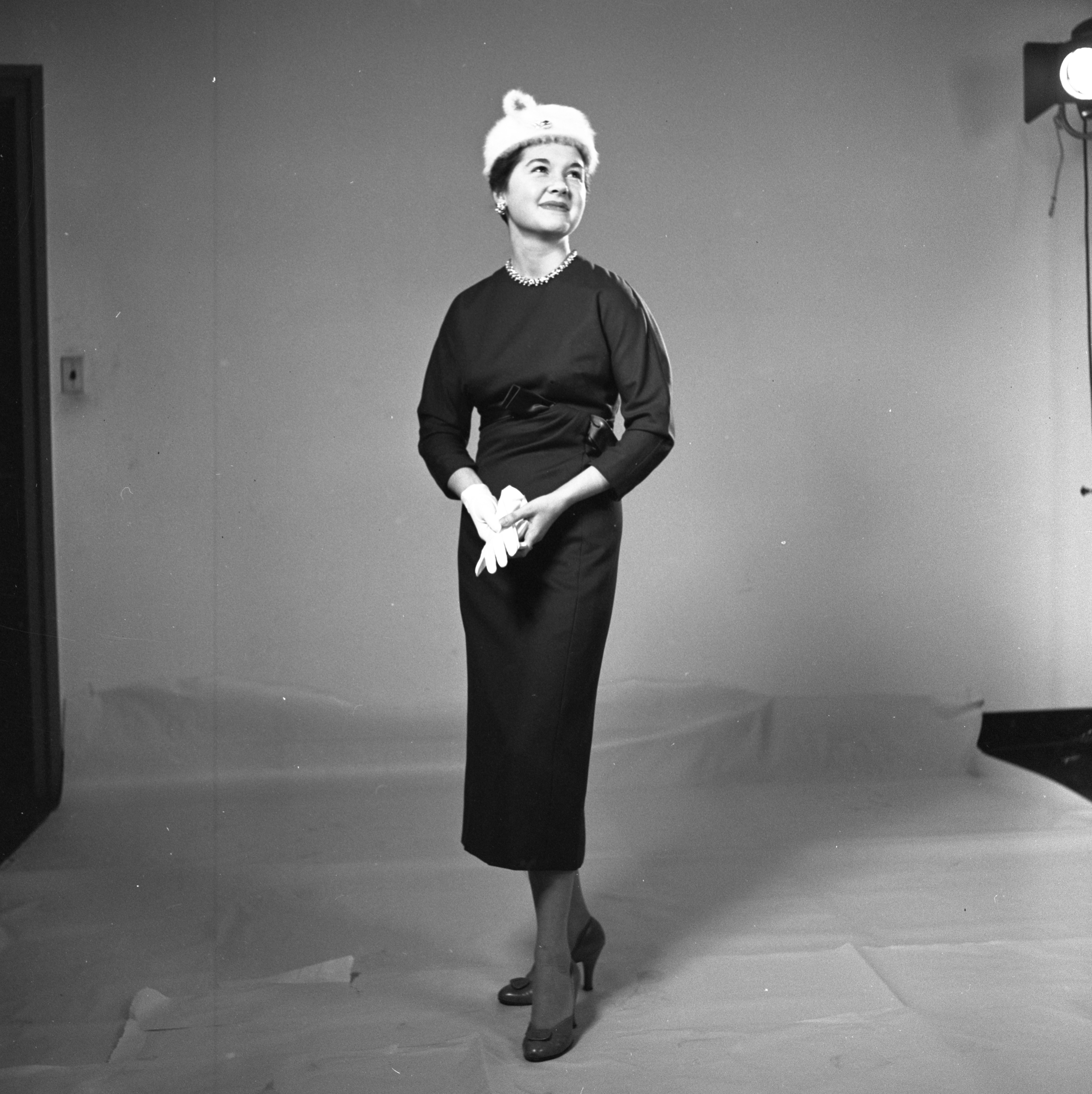Mrs. Walter Stein Models A Wool Dress, October 1956 image