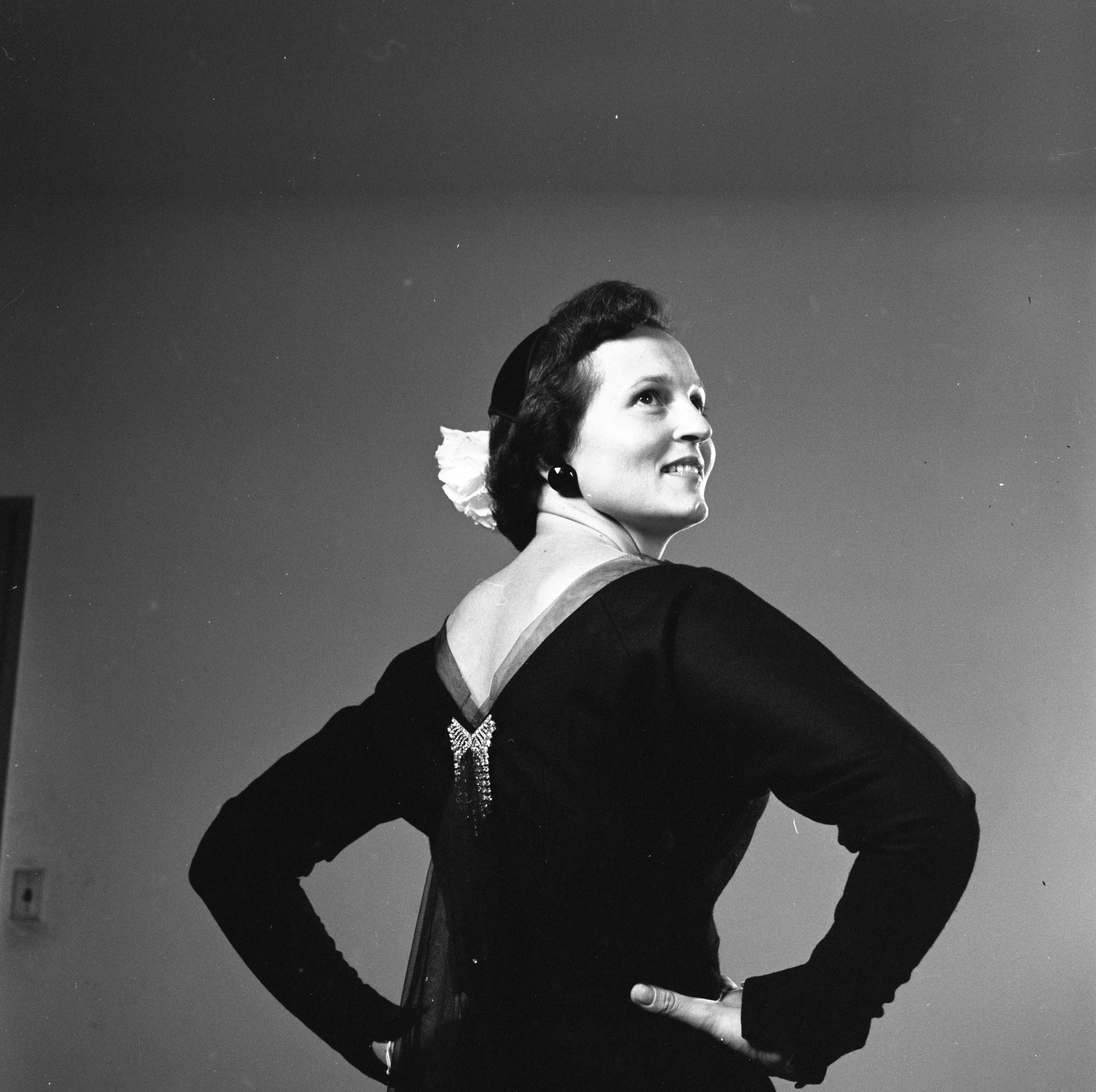 Marian Allmand Models A V-Backed Fall Dress, October 1956 image