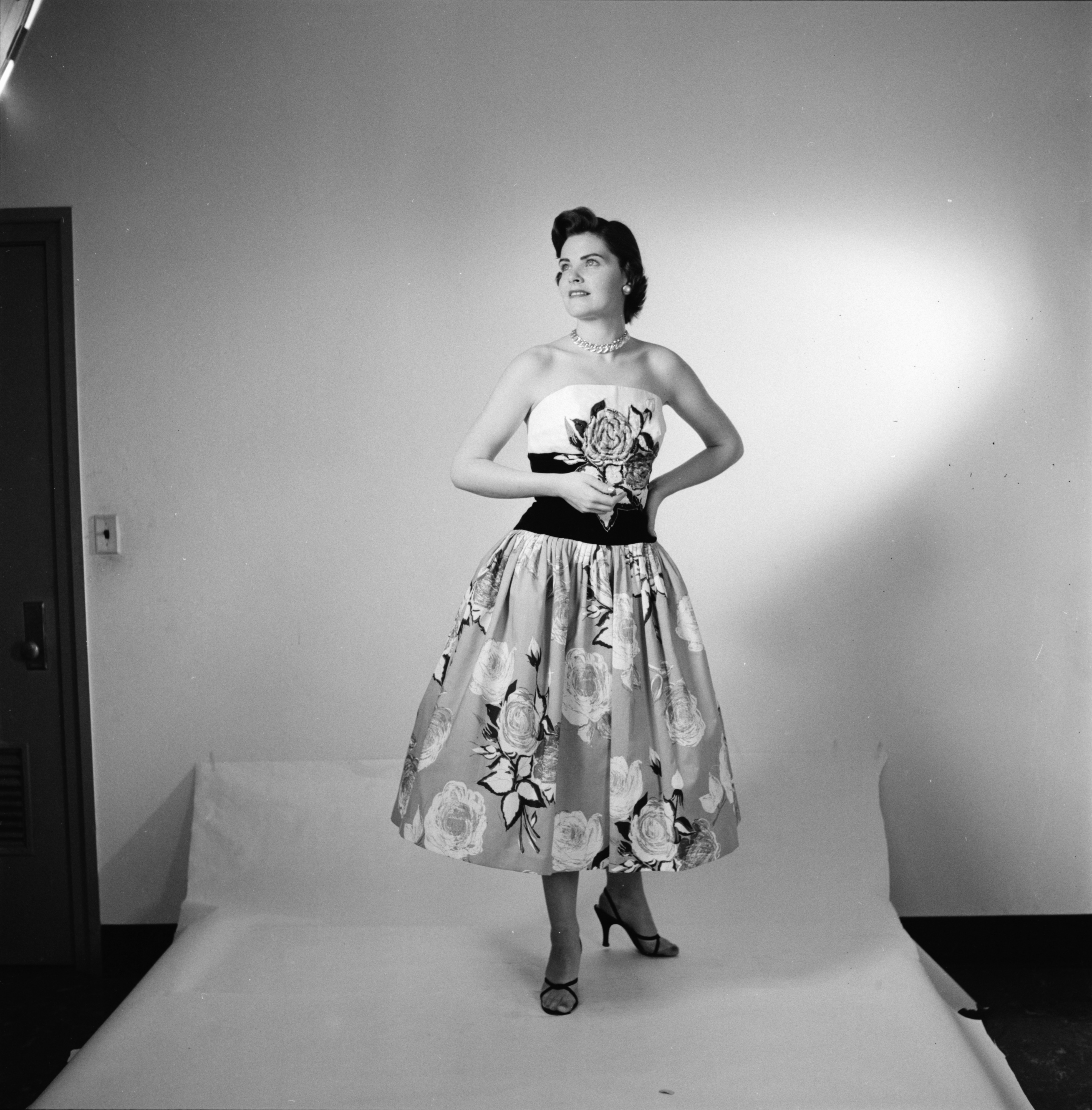 Harriet M. Rose models a cotton printed dress in the Michigan Dames' Fashion Show, March 1957 image