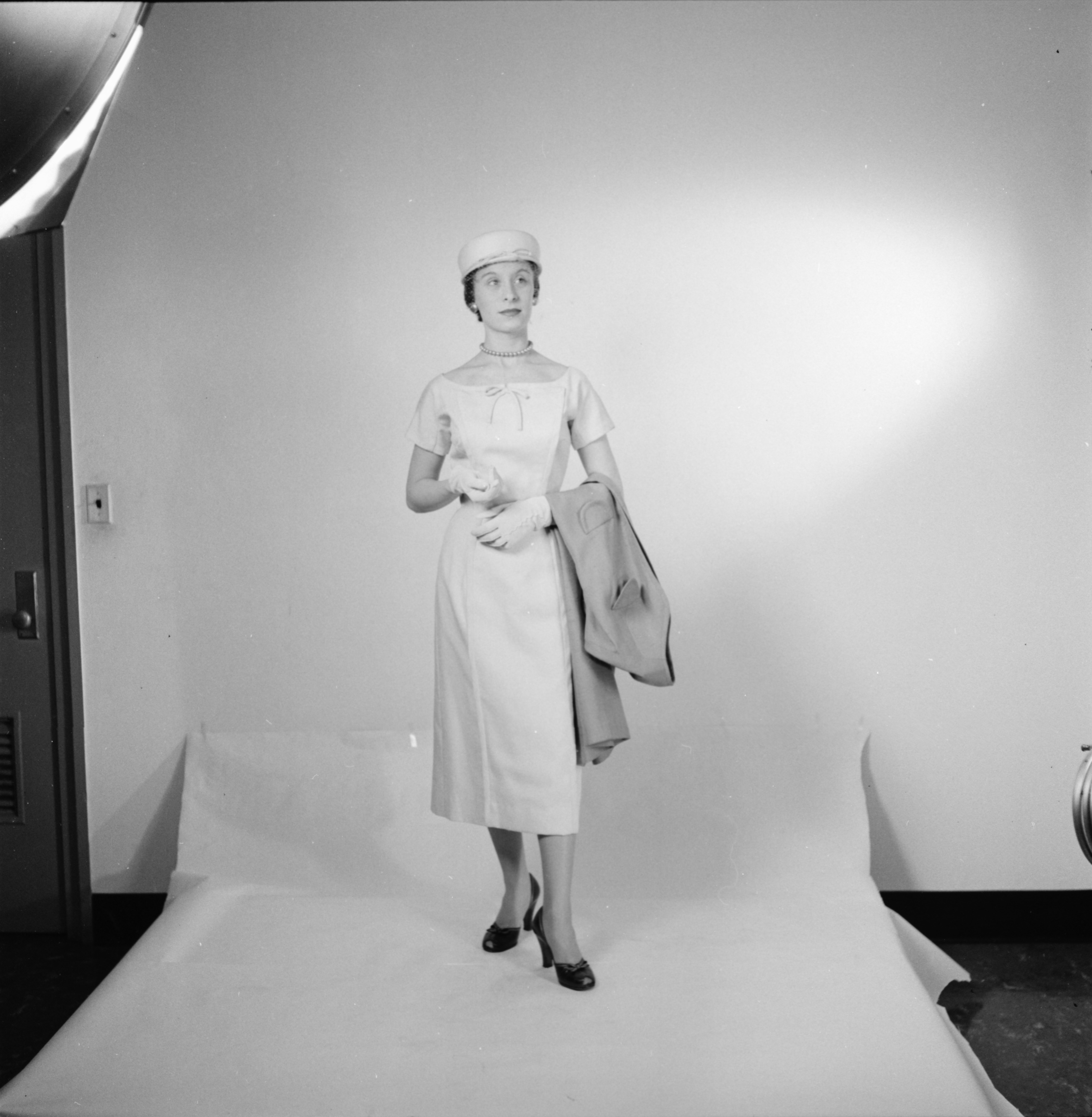 Sandra Norrian models an easy-to-wear ensemble in the Michigan Dames' Fashion Show, March 1957 image