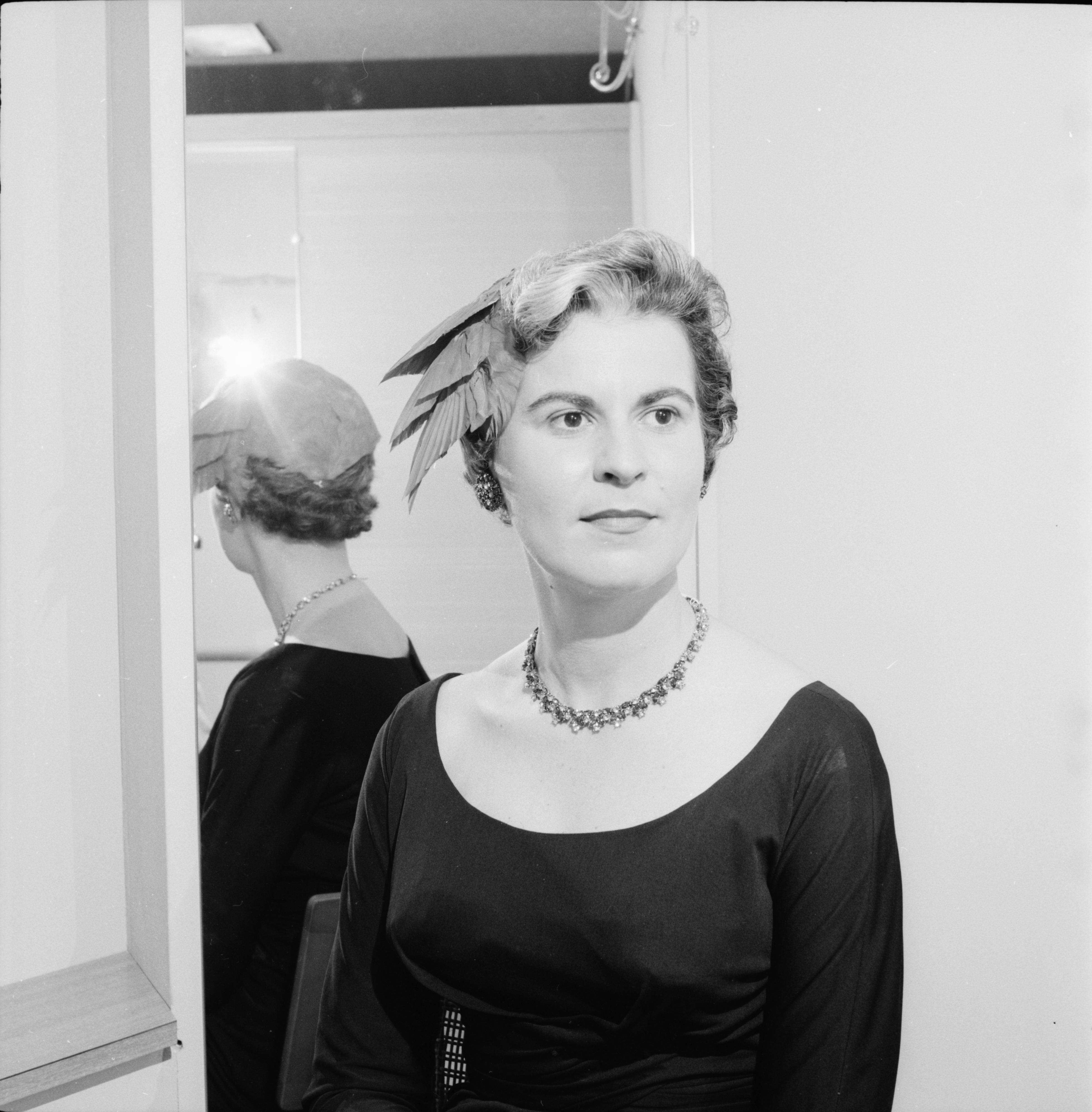 "Mrs. Richard Graham models a hat for Barton Hills Country Club millinery show, ""Autumn Finale,"" September 1959 image"