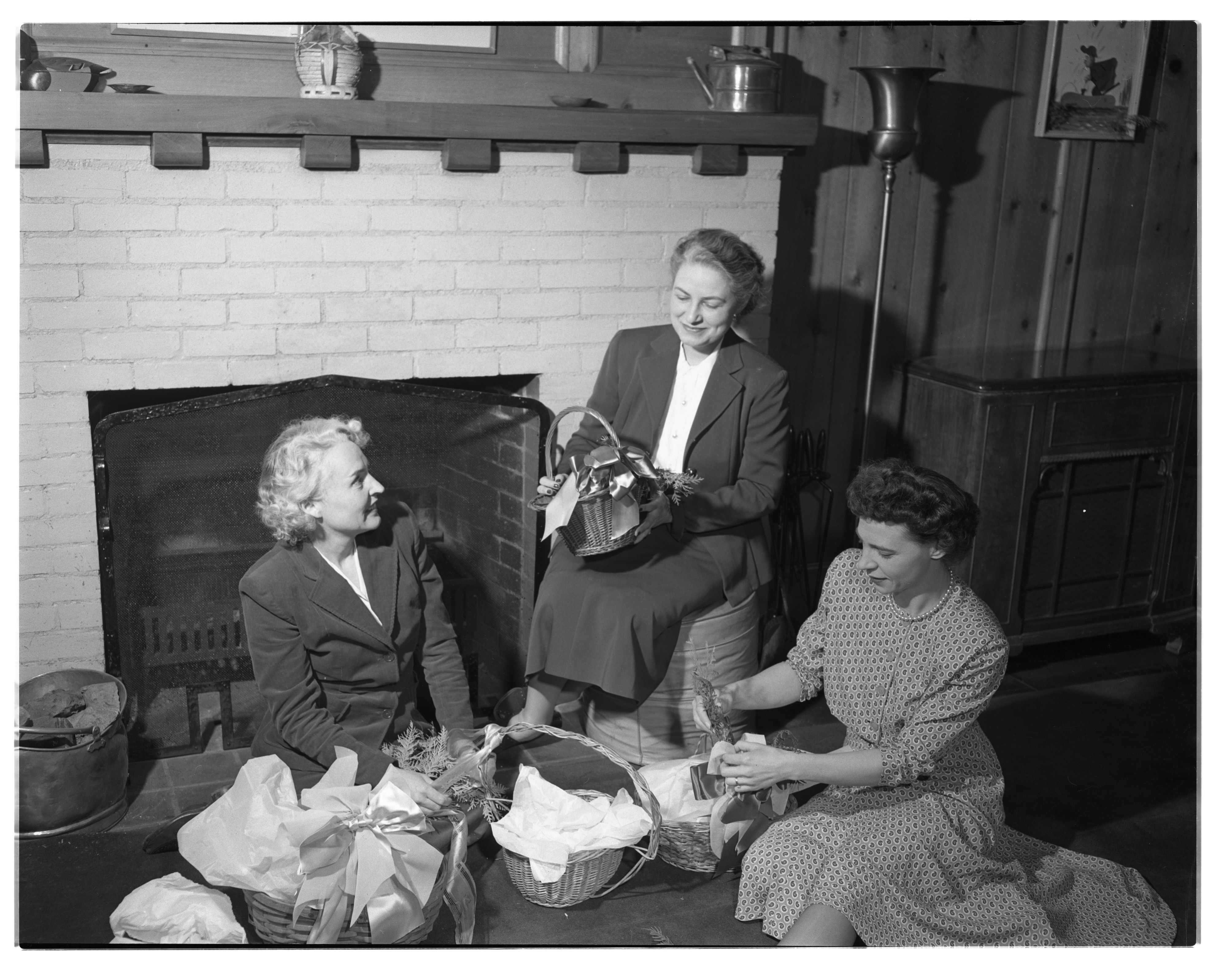 Thrift Shop Members Prepare Christmas Baskets For Needy, December 1948 image
