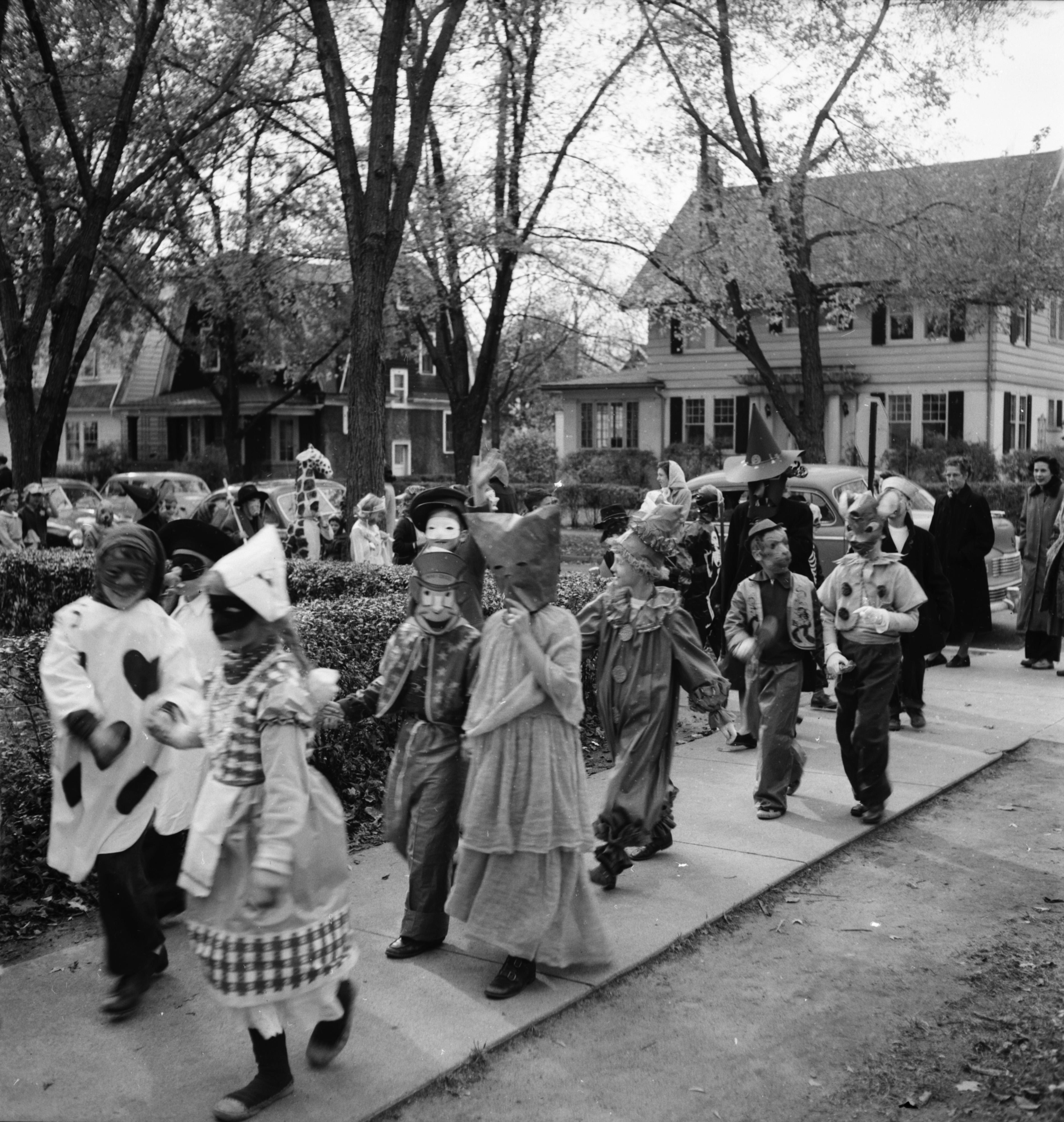 a little dutch girl in the burns park school halloween parade, 1951