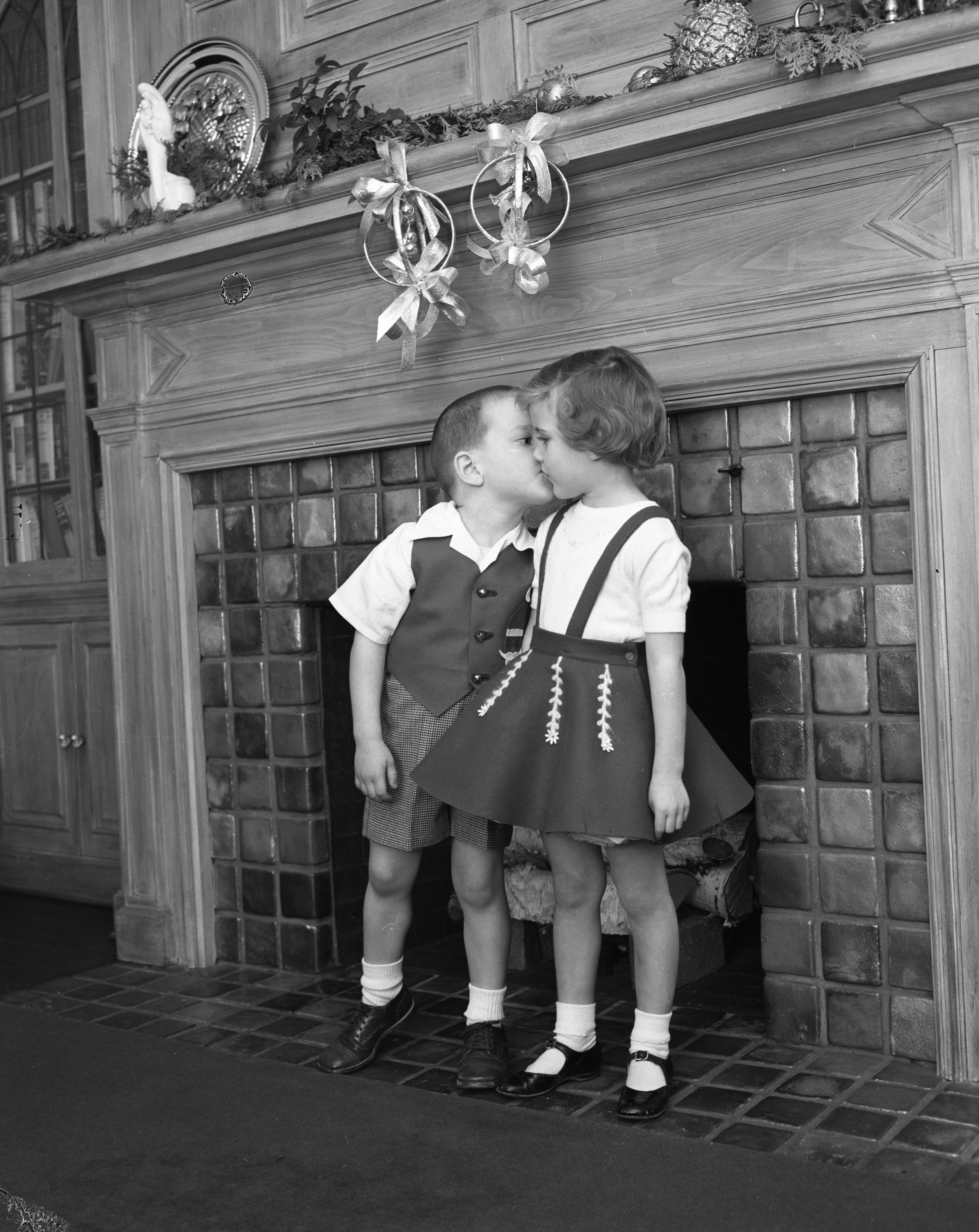 Charles Lighthall and Ann DeVine kiss under Christmas bells ...